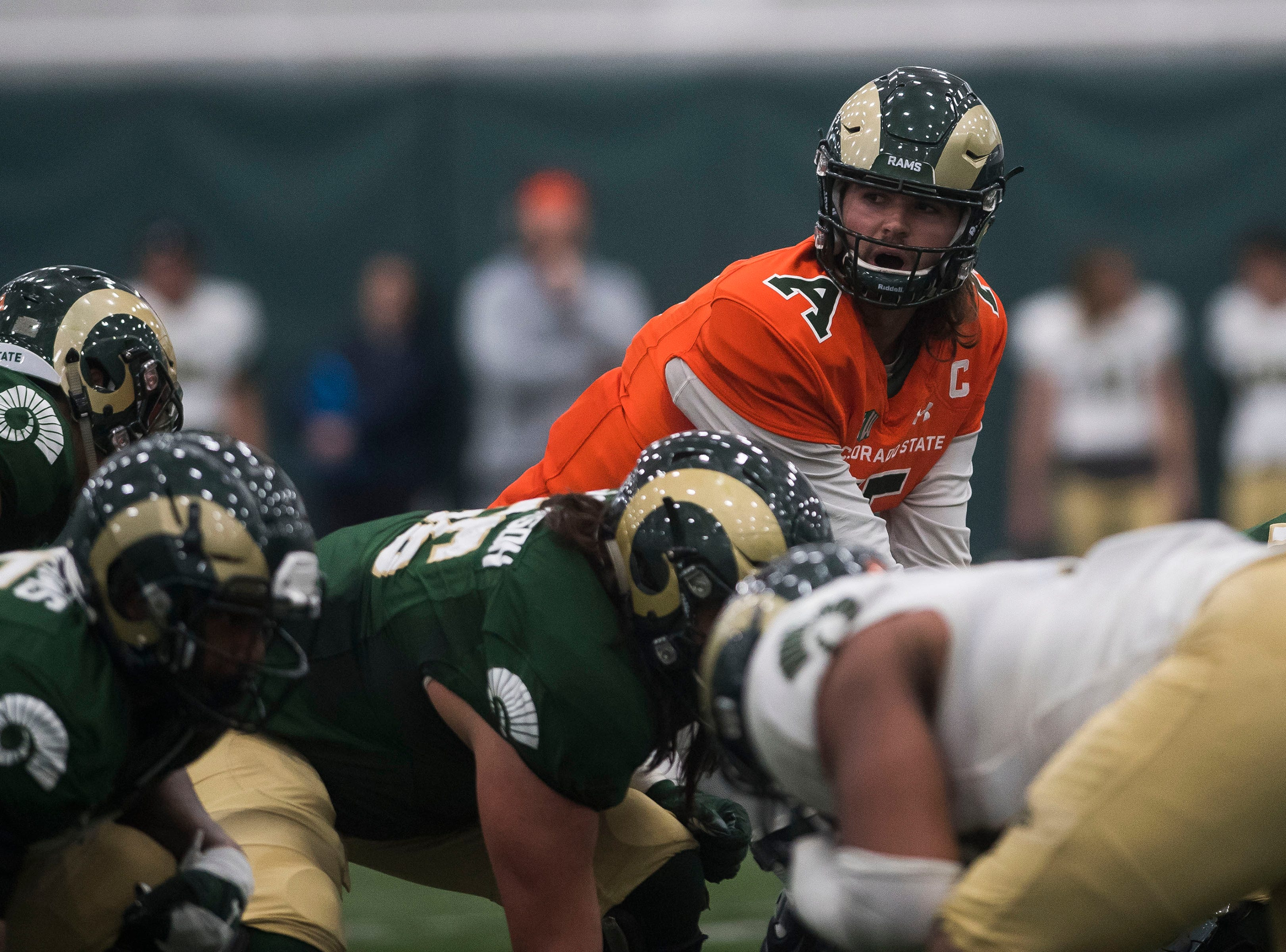 CSU junior quarterback Colin Hill (15) makes a call to his offense during CSU's Spring game on Thursday, March 14, 2019, at their indoor practice facility in Fort Collins, Colo.