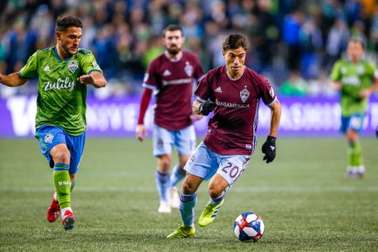 Nicolas Mezquida, shown moving the ball downfield during a March 9 game at Seattle, and the Colorado Rapids will play a home game at 7 p.m. Saturday against Sporting KC at Dick's Sporting Goods Park in Commerce City.
