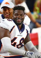 Denver Broncos linebacker and former CSU football star Shaq Barrett is all smiles on the sidelines during an Aug. 30 , 2018, preseason games against the Arizona Cardinals in Phoenix. Barrett agreed to terms on a one-year deal with the Tampa Bay Buccaneers on Friday, the NFL team announced.