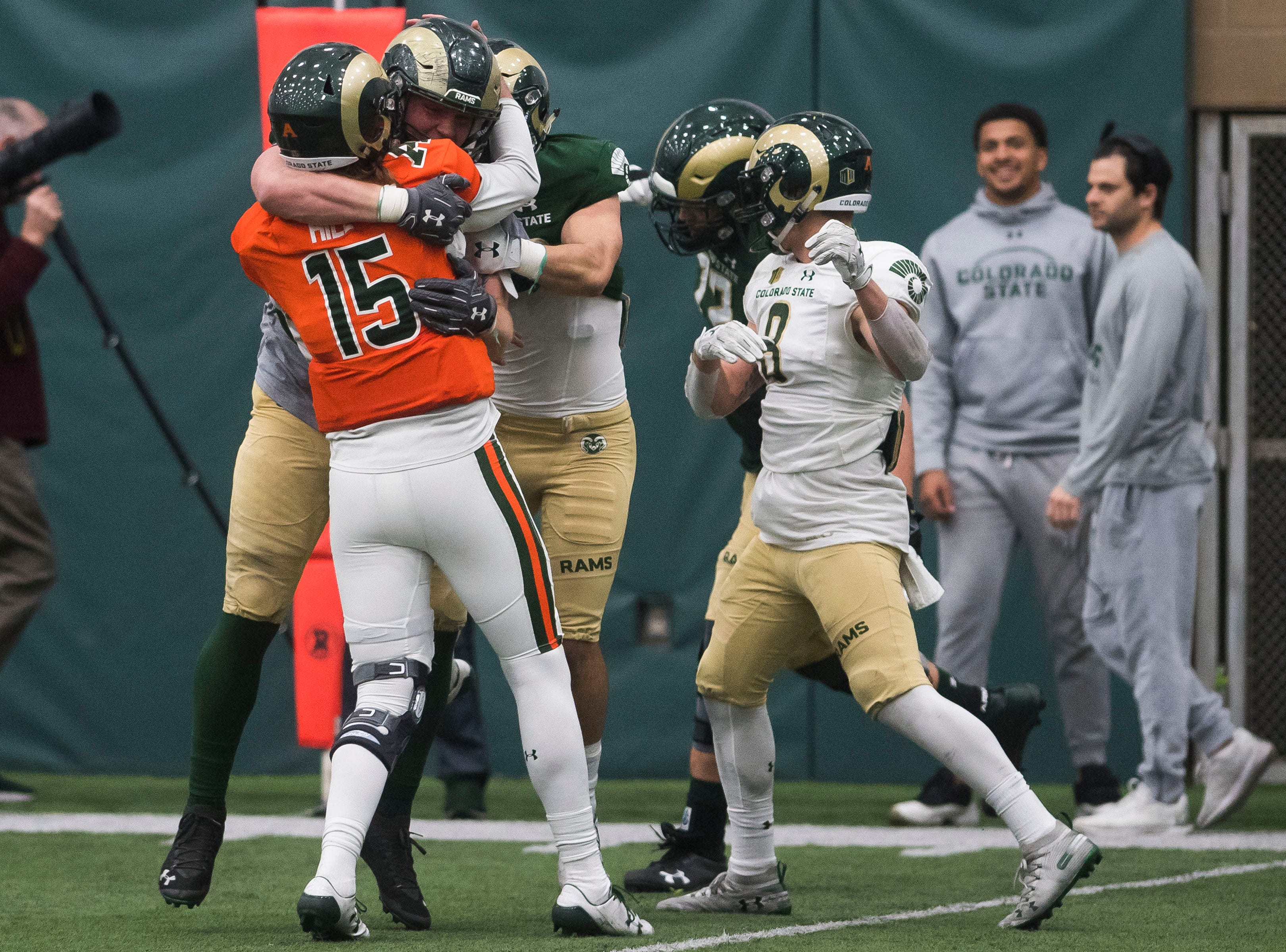 CSU sophomore tight end Trey McBride (85) hugs junior quarterback Colin Hill (15) after connecting for the winning touchdown reception during CSU's Spring game on Thursday, March 14, 2019, at their indoor practice facility in Fort Collins, Colo.