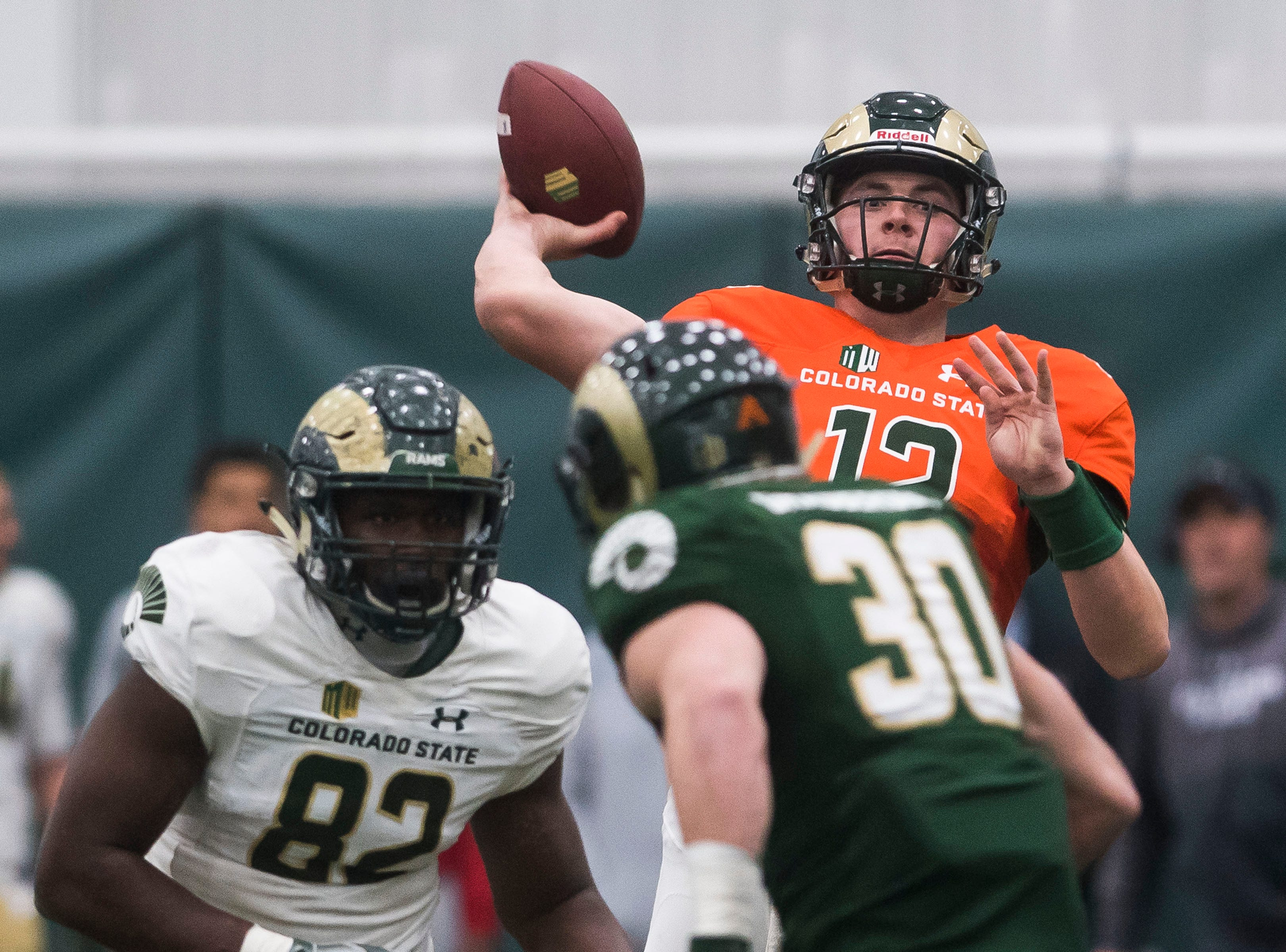CSU junior quarterback Patrick O'Brien (12) attempts a pass during CSU's Spring game on Thursday, March 14, 2019, at their indoor practice facility in Fort Collins, Colo.