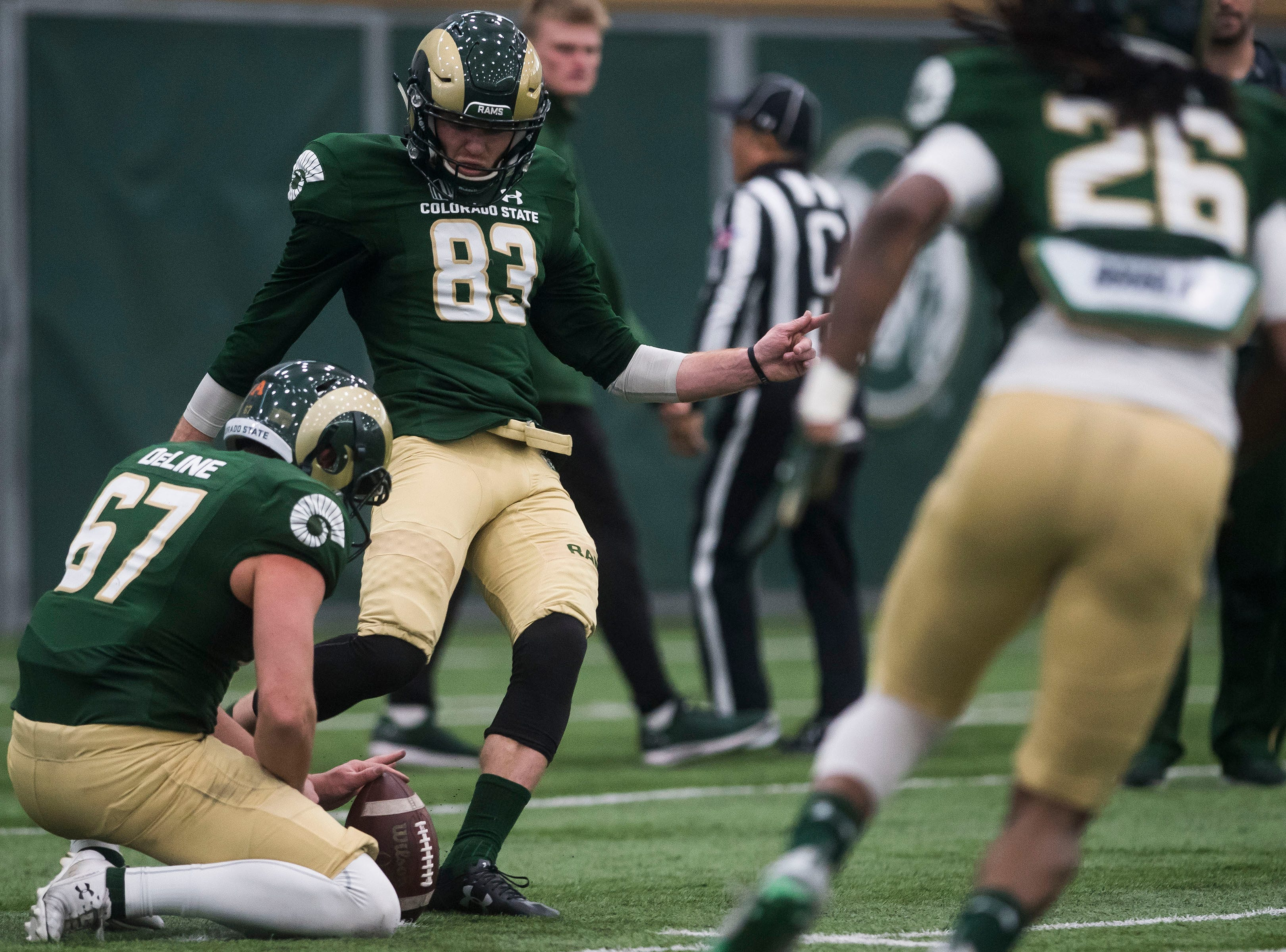CSU senior kicker Braxton Davis (83) kicks a field goal during CSU's Spring game on Thursday, March 14, 2019, at their indoor practice facility in Fort Collins, Colo.