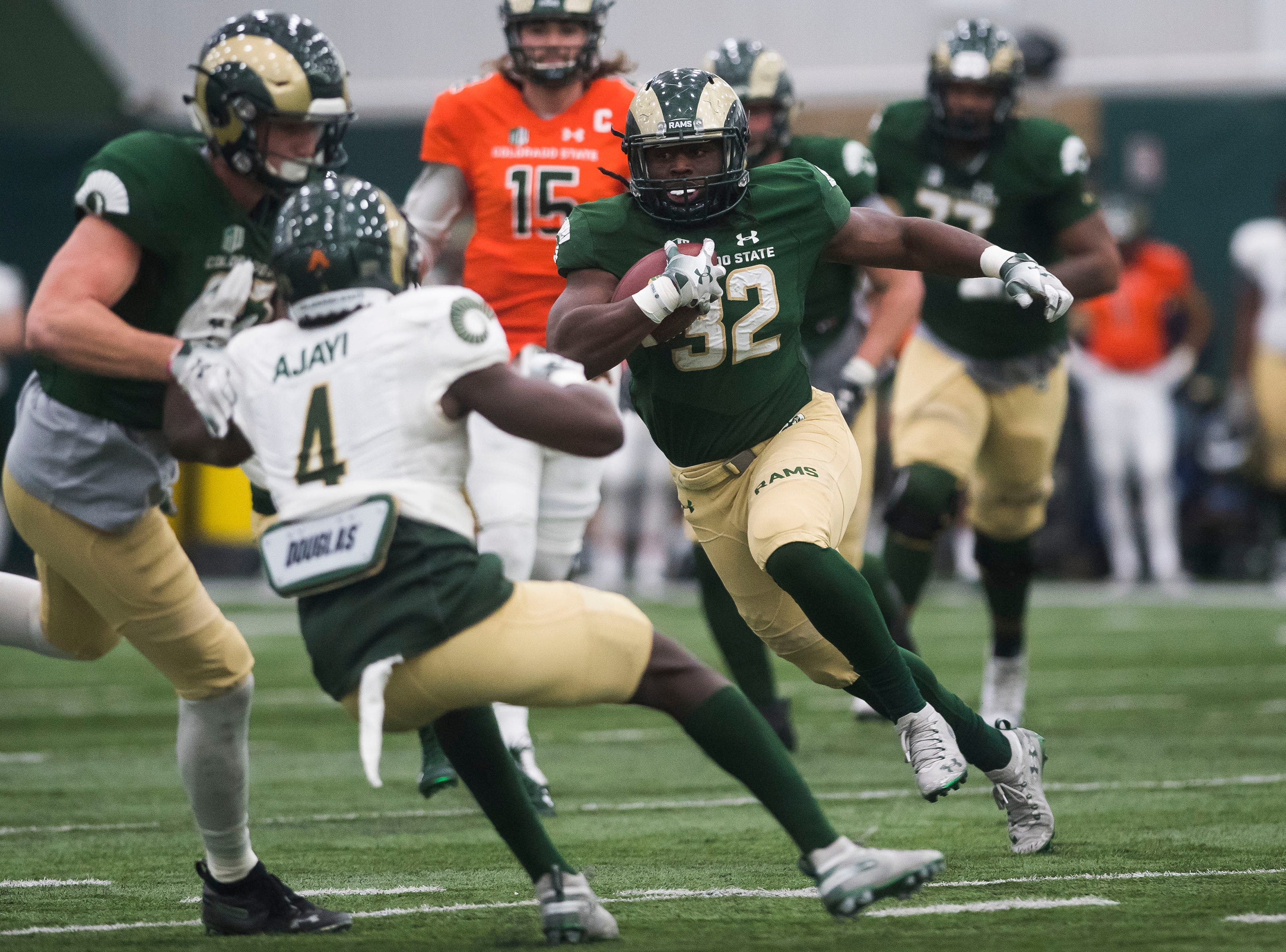 CSU junior running back Marcus McElrow (32) cuts behind a blocker during CSU's Spring game on Thursday, March 14, 2019, at their indoor practice facility in Fort Collins, Colo.