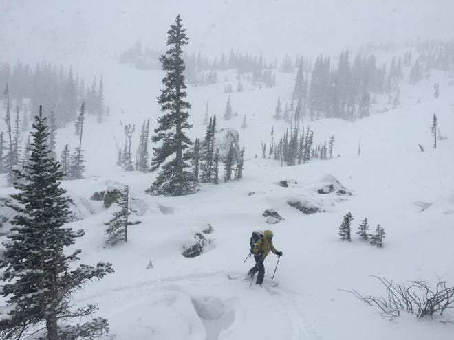 A searcher braves the cold and snow March 6 to look for James Pruitt in the Lake Haiyaha area of Rocky Mountain National Park.