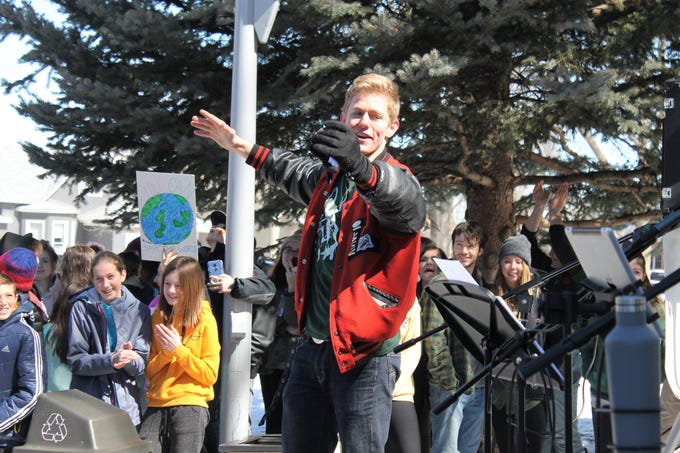 Ehret Nottingham, a senior at Loveland High School, leads a chant March 15, 2019. Hundreds of students from Thompson School District and Poudre School District ditched class to call for better climate policy.