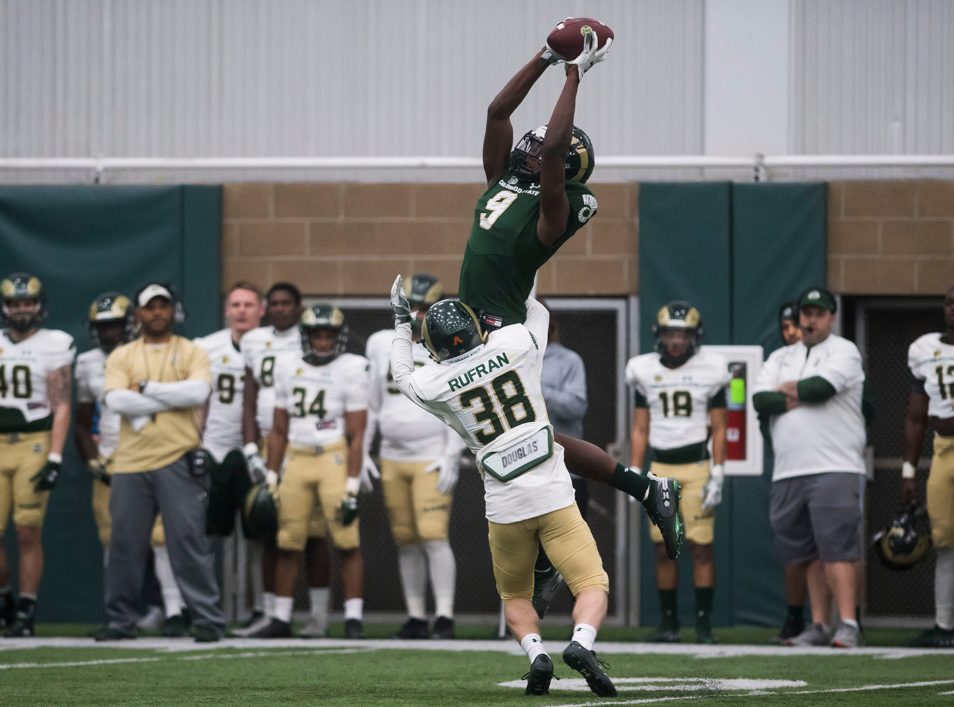 CSU junior wide receiver Warren Jackson (9) pulls in a reception while being defended by sophomore cornerback Adonis Rufran (38) during CSU's Spring game on Thursday, March 14, 2019, at their indoor practice facility in Fort Collins, Colo.