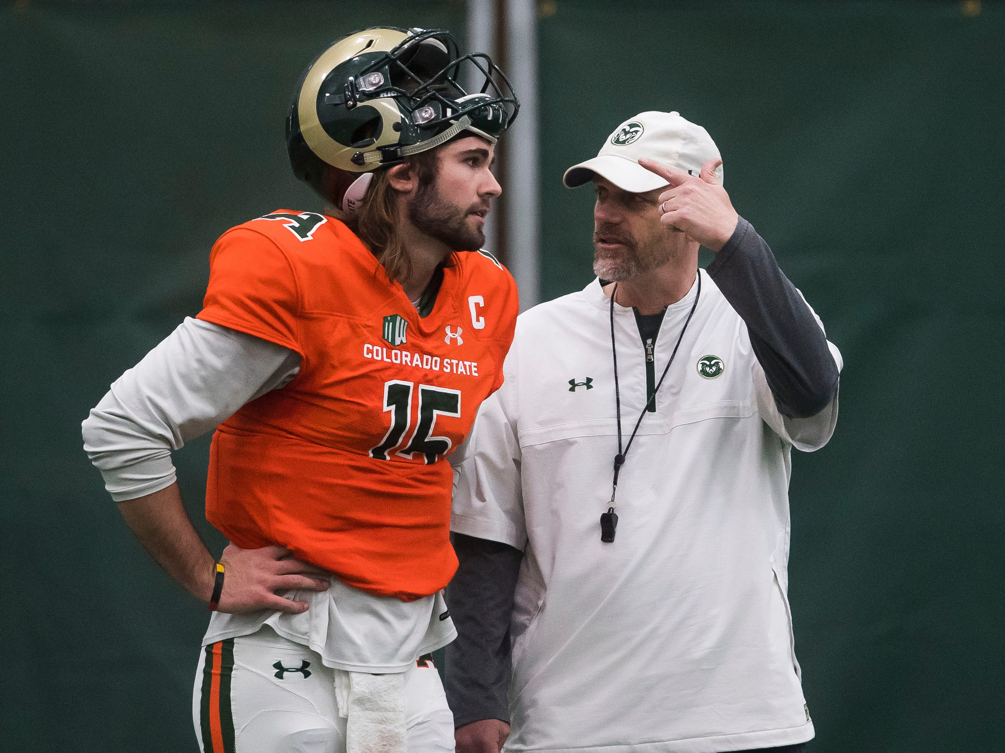 CSU head coach Mike Bobo talks with junior quarterback Colin Hill (15) during CSU's Spring game on Thursday, March 14, 2019, at their indoor practice facility in Fort Collins, Colo.