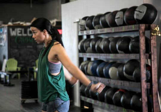 Annabelle Tometich warms up for the CrossFit Open 19.4 workout on Friday, March 15, 2019, at CrossFit 239 in Fort Myers.