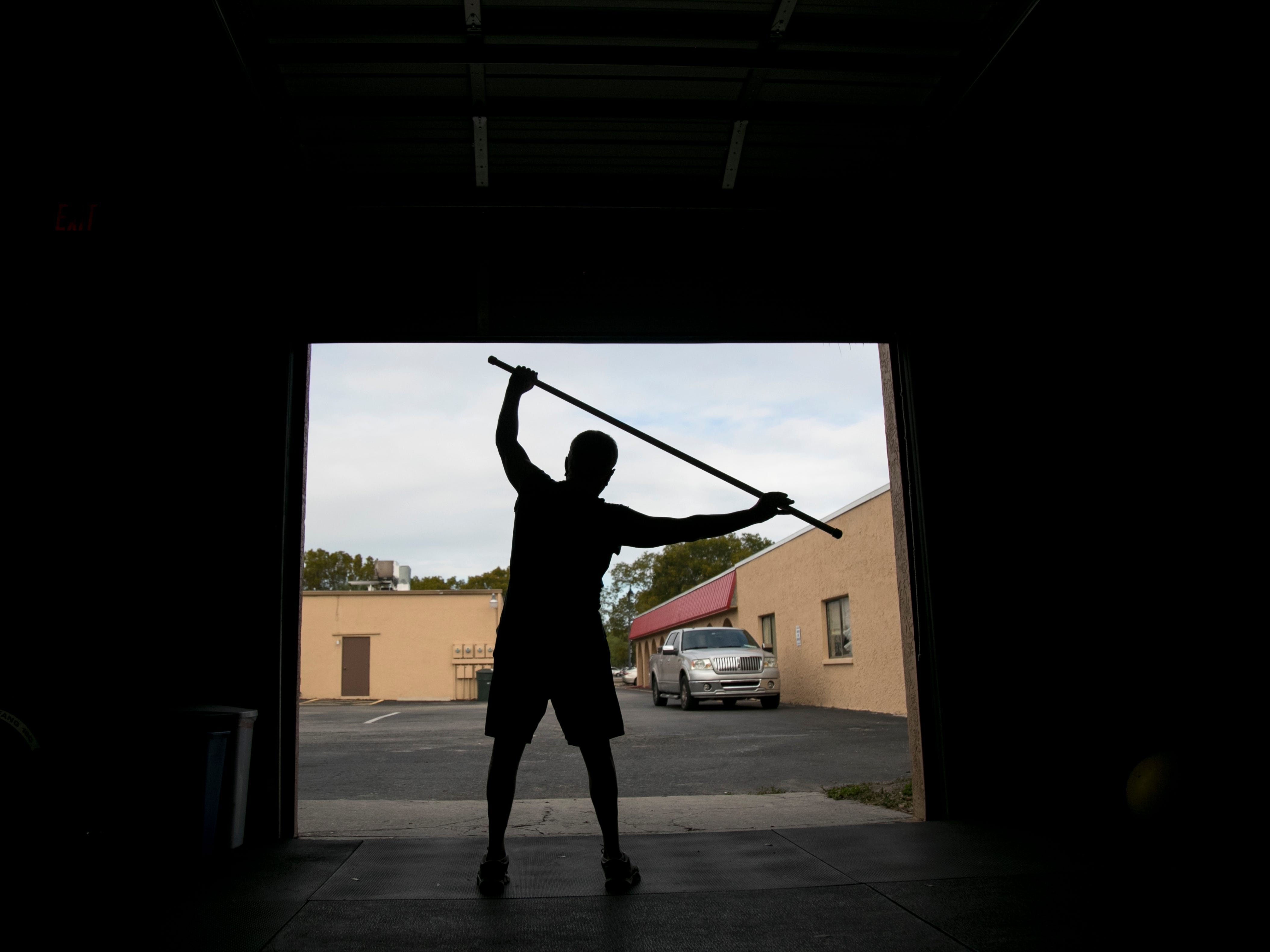 Bill Hanney, 62, stretches after the CrossFit Open 19.4 workout on Friday, March 15, 2019, at CrossFit 239 in Fort Myers.