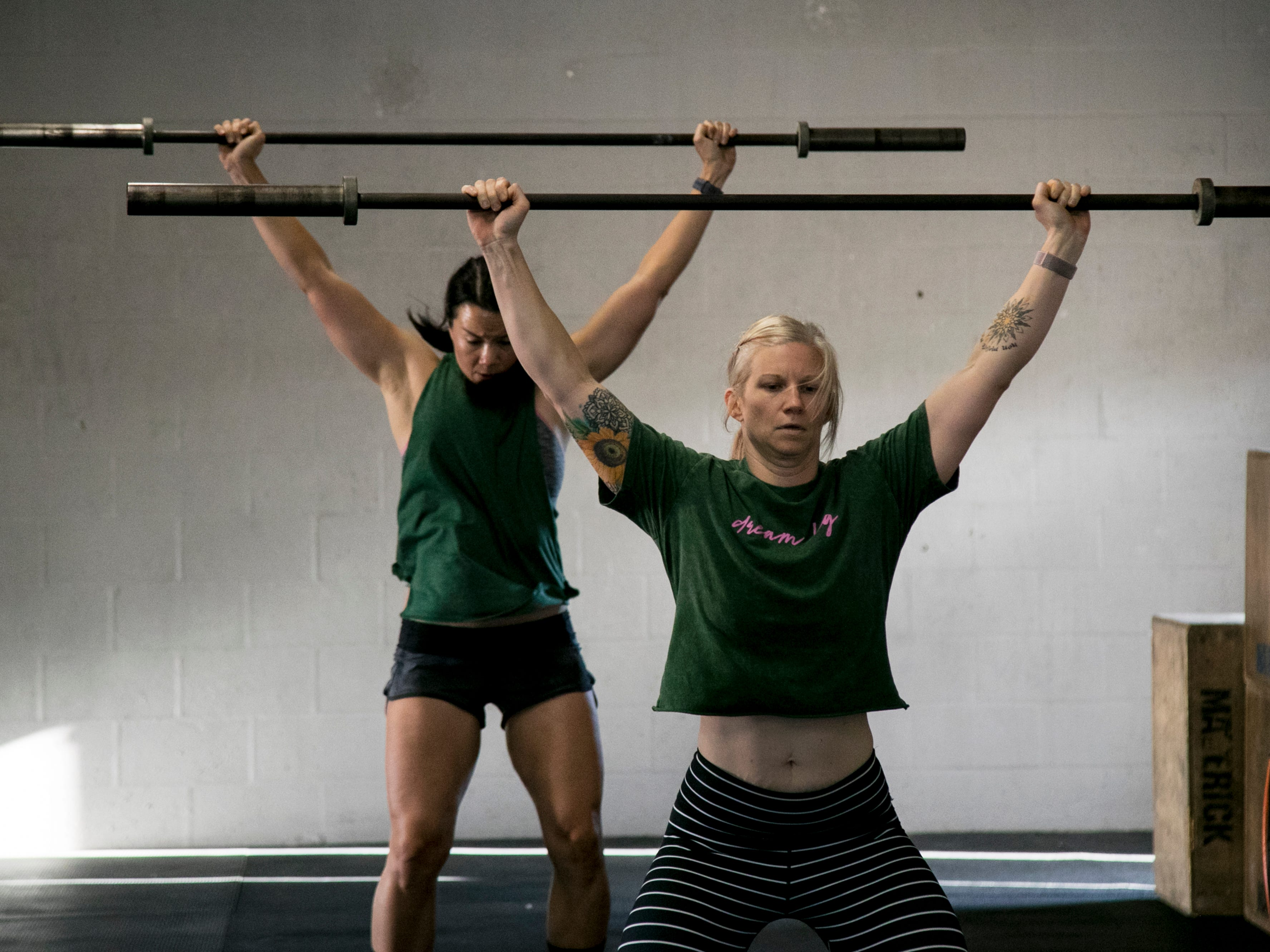 Kari Connors, right, and Annabelle Tometich warm up before the CrossFit Open 19.4 workout on Friday, March 15, 2019, at CrossFit 239 in Fort Myers.