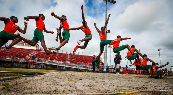 Wolfpack Invitational track meet at South Fort Myers, March 15, 2019. Jeremiah Davis, of  Lehigh, won the boys long jump, Greg Thomas, Greg a sophomore at Dunbar.