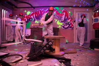 Anson Rosenwald, his wife Alisha Koyanis and son Matthew relieve stress by smashing things at Just One of Those Dayz Smash Room in Fort Myers.