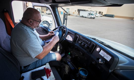 Larry Hubble, a driver for LeeSar, a healthcare supply company in Fort Myers, prepares his delivery truck Friday morning March 15, 2019.  Local businesses in Southwest Florida weigh in on how the rise in gas prices may be impacting their day to day operations.