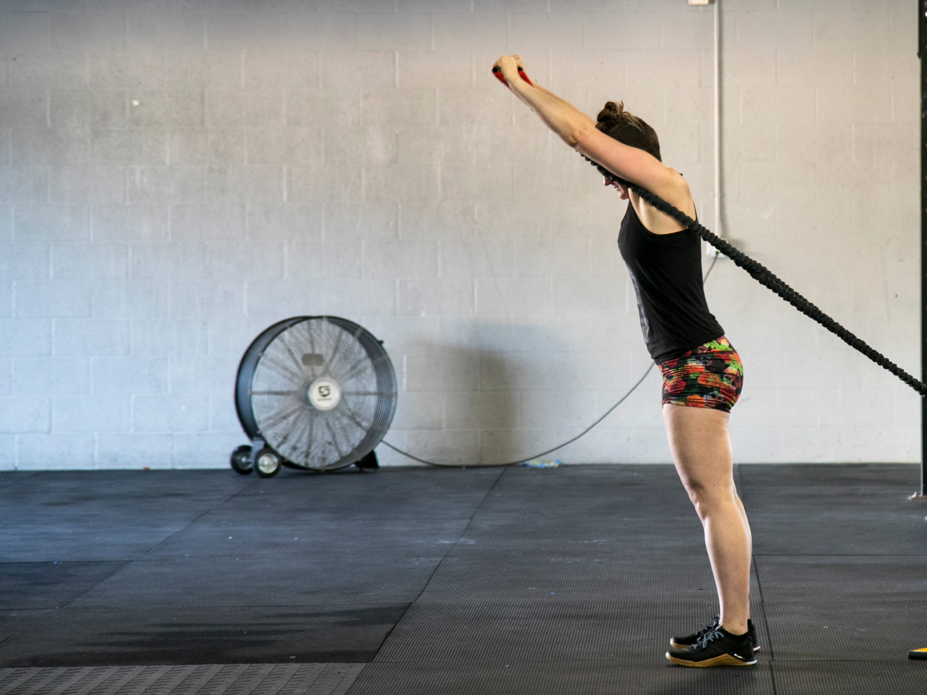 Caroline Lowman stretches after the CrossFit Open 19.4 workout on Friday, March 15, 2019, at CrossFit 239 in Fort Myers.