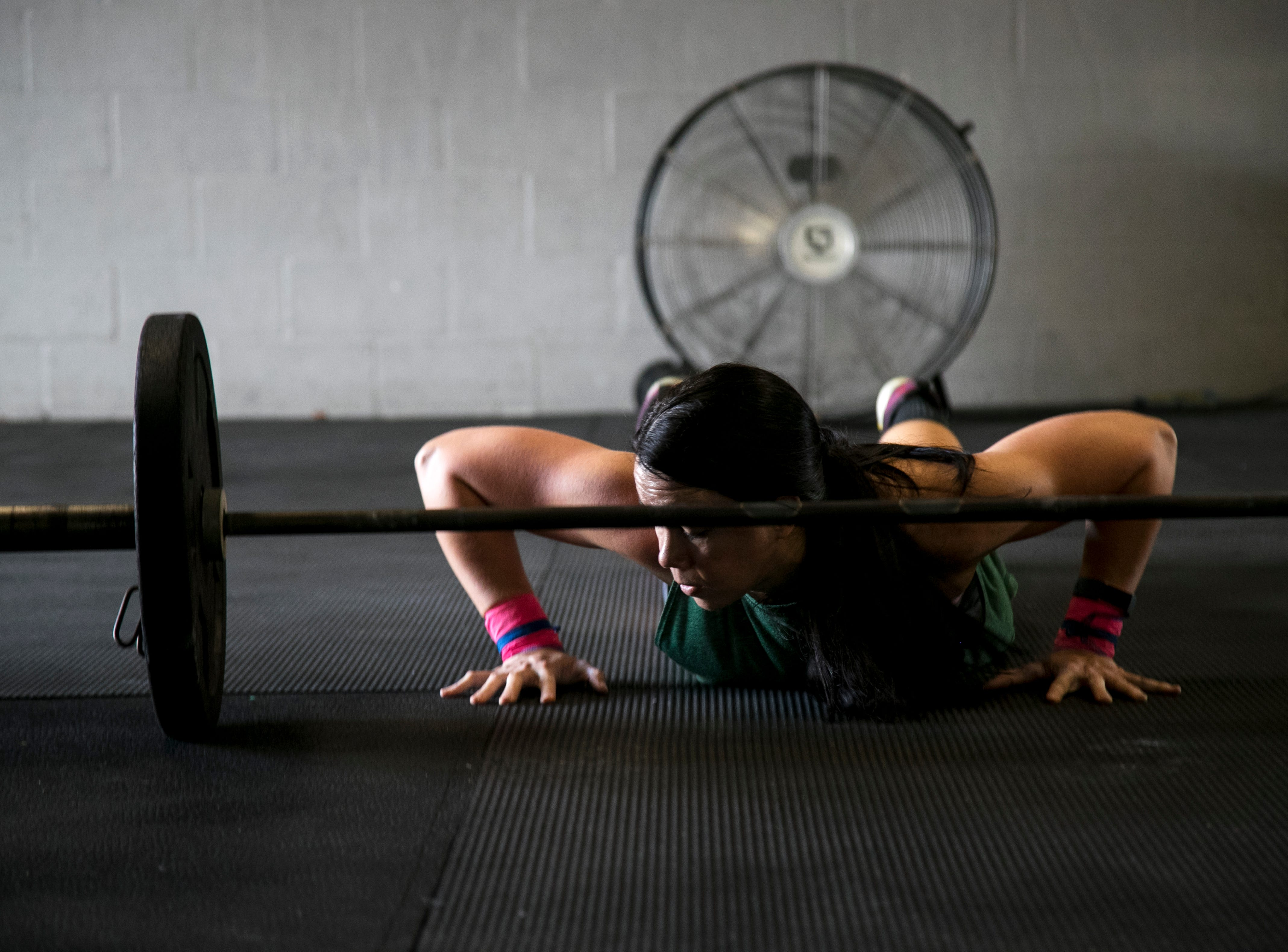 Annabelle Tometich does burpees during the CrossFit Open 19.4 workout on Friday, March 15, 2019, at CrossFit 239 in Fort Myers.