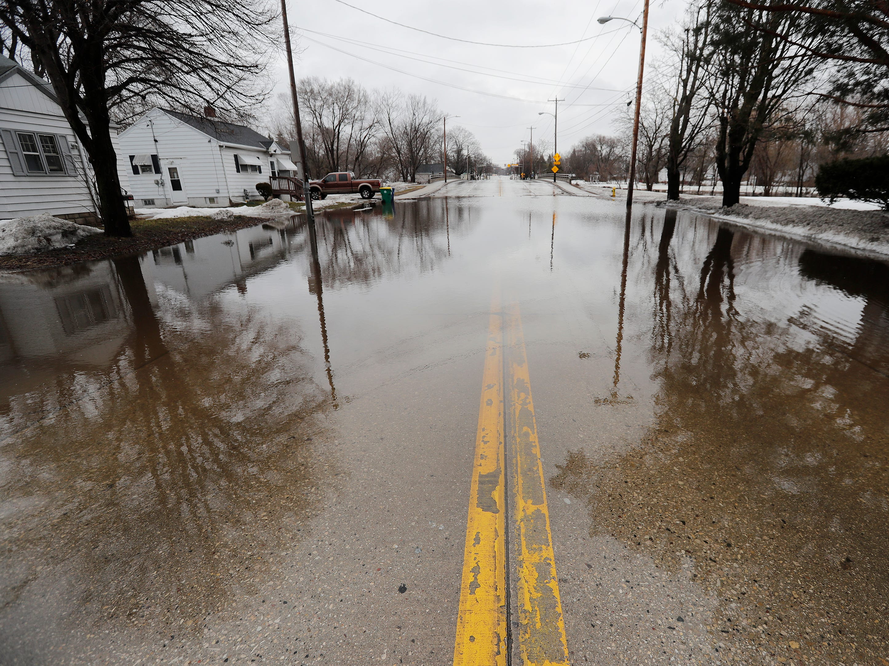 Mason Street is closed due to floodwaters from the East river on Friday, March 15, 2019 in Green Bay, Wis.