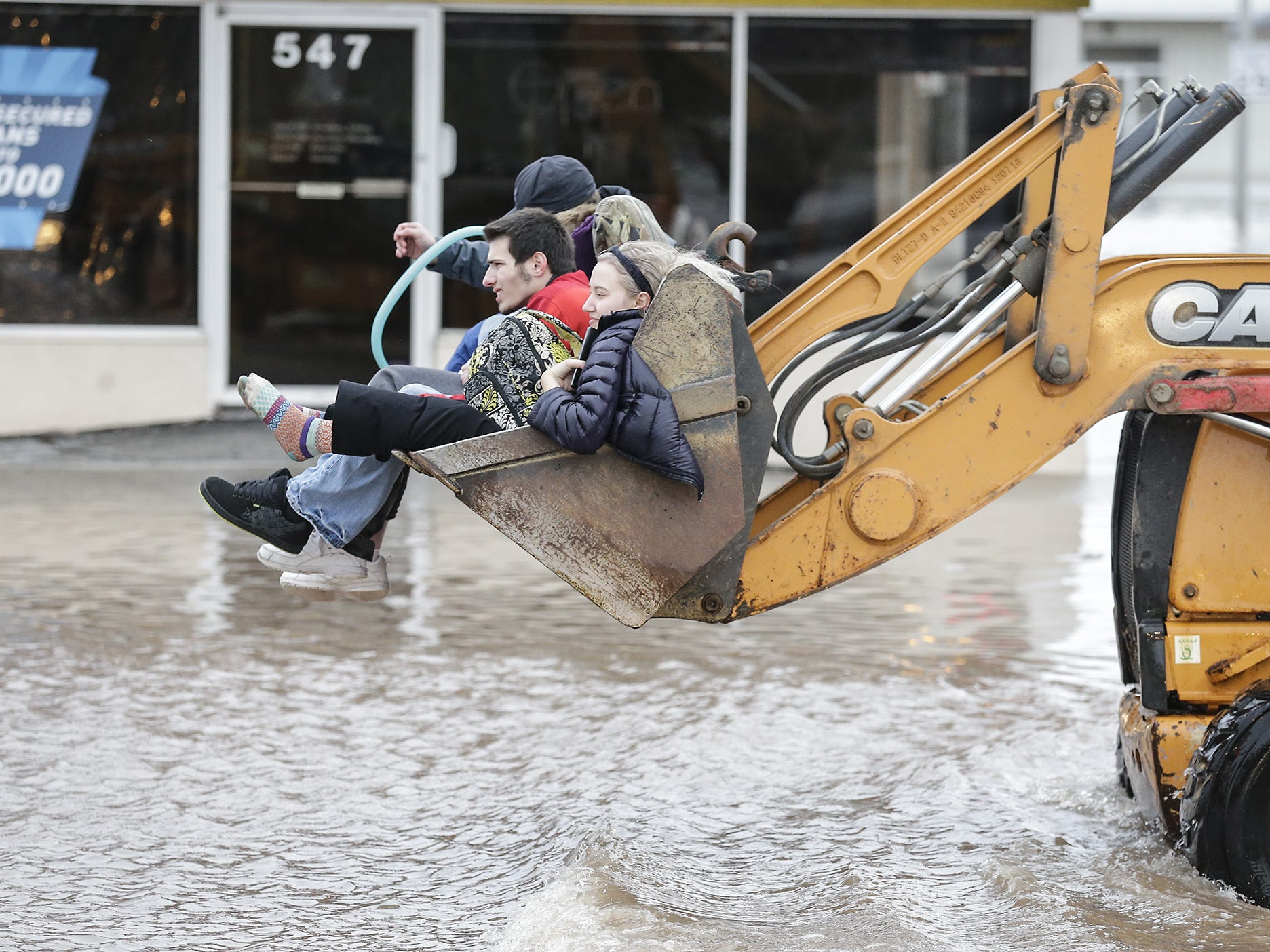 Four people are evacuated from a flooded area Thursday, March 14, 2019 on Johnson Street in Fond du Lac, Wis. Ice jams on the east branch of the Fond du Lac River and heavy rain caused widespread flooding problems in the city. Doug Raflik/USA TODAY NETWORK-Wisconsin