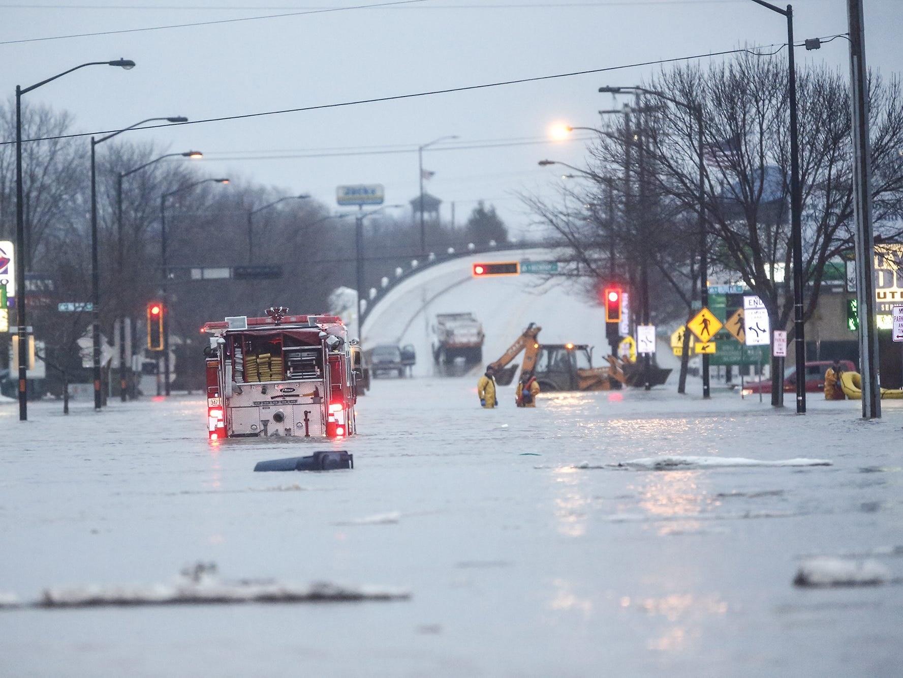 A Ripon fire truck makes it's way down a flooded Johnson Street Thursday, March 14, 2019. Ice jams on the east branch of the Fond du Lac River and heavy rain caused widespread flooding problems in the city. Doug Raflik/USA TODAY NETWORK-Wisconsin