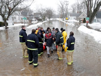 Homes were evacuated and bridges closed in Green Bay when rain and melting snow flooded neighborhoods near the East River.