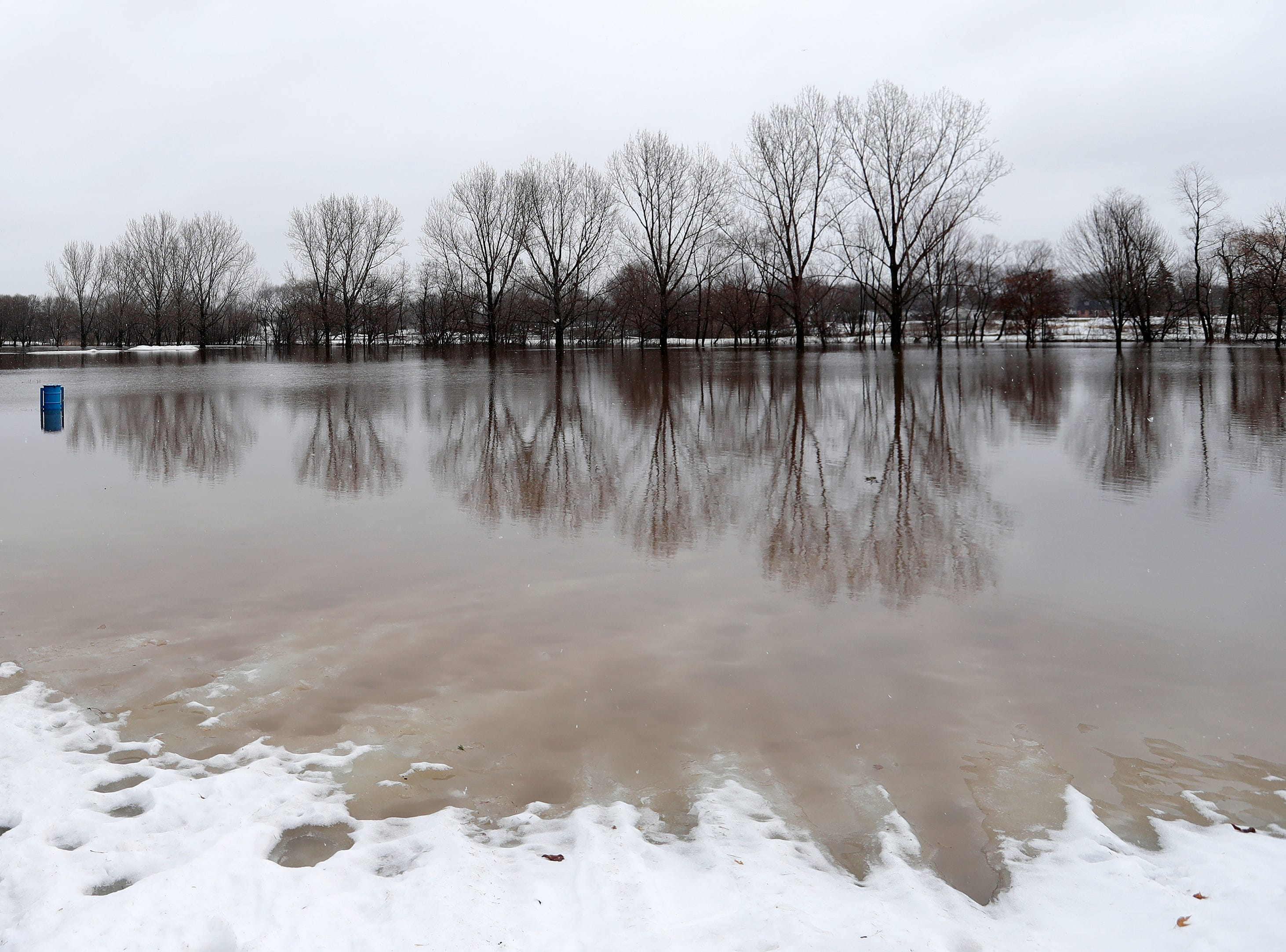 The flooding East river is shown on Friday, March 15, 2019 in Green Bay, Wis.