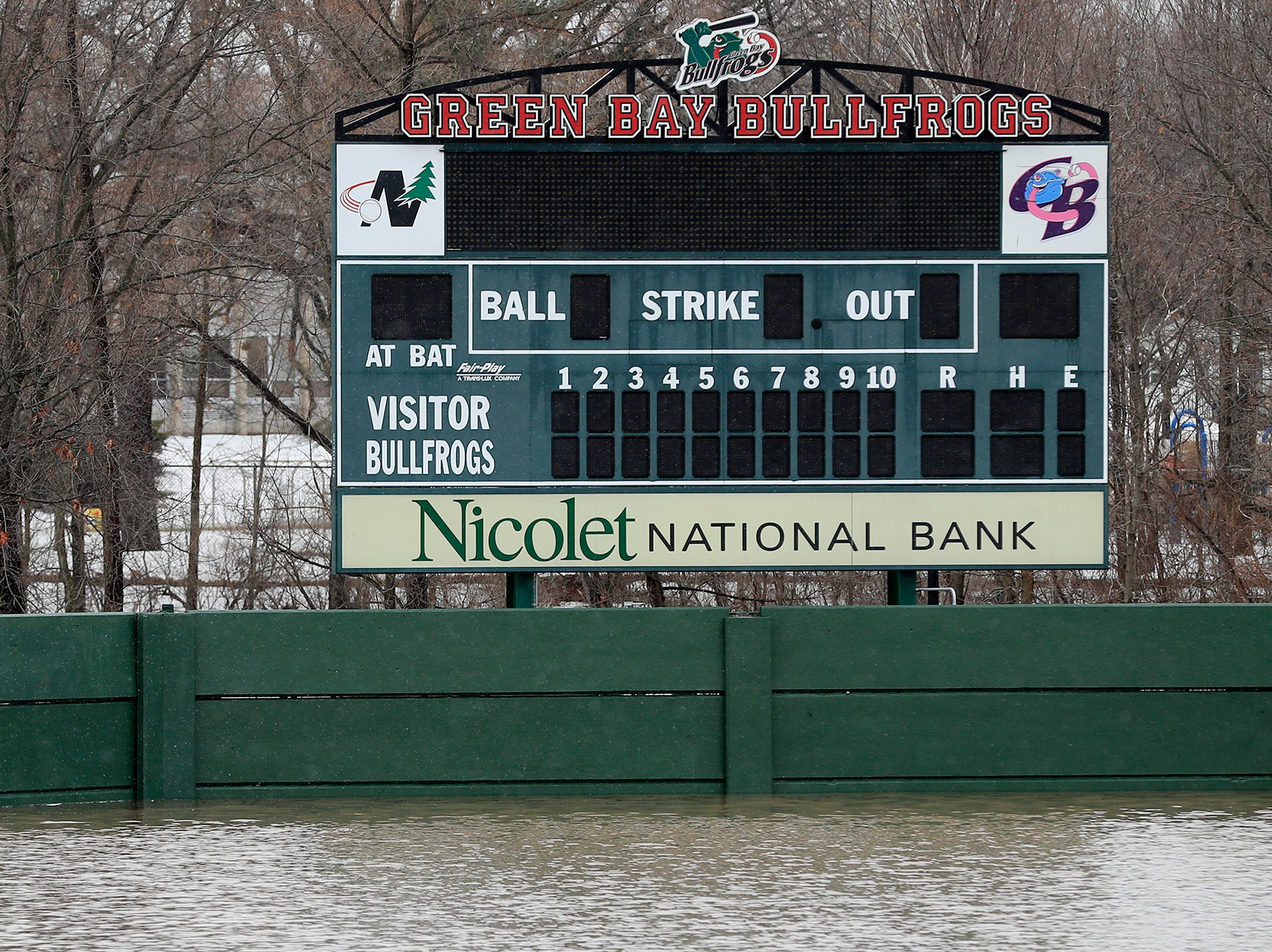 The baseball stadium at Joannes Park is submerged by floodwaters from the East river on Friday, March 15, 2019 in Green Bay, Wis.