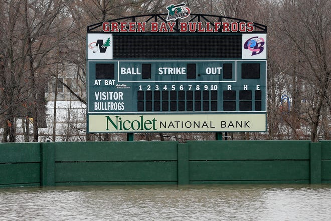 The baseball stadium at Joannes Park is submerged by floodwaters from the East river on Friday, March 15, 2019, in Green Bay, Wis.