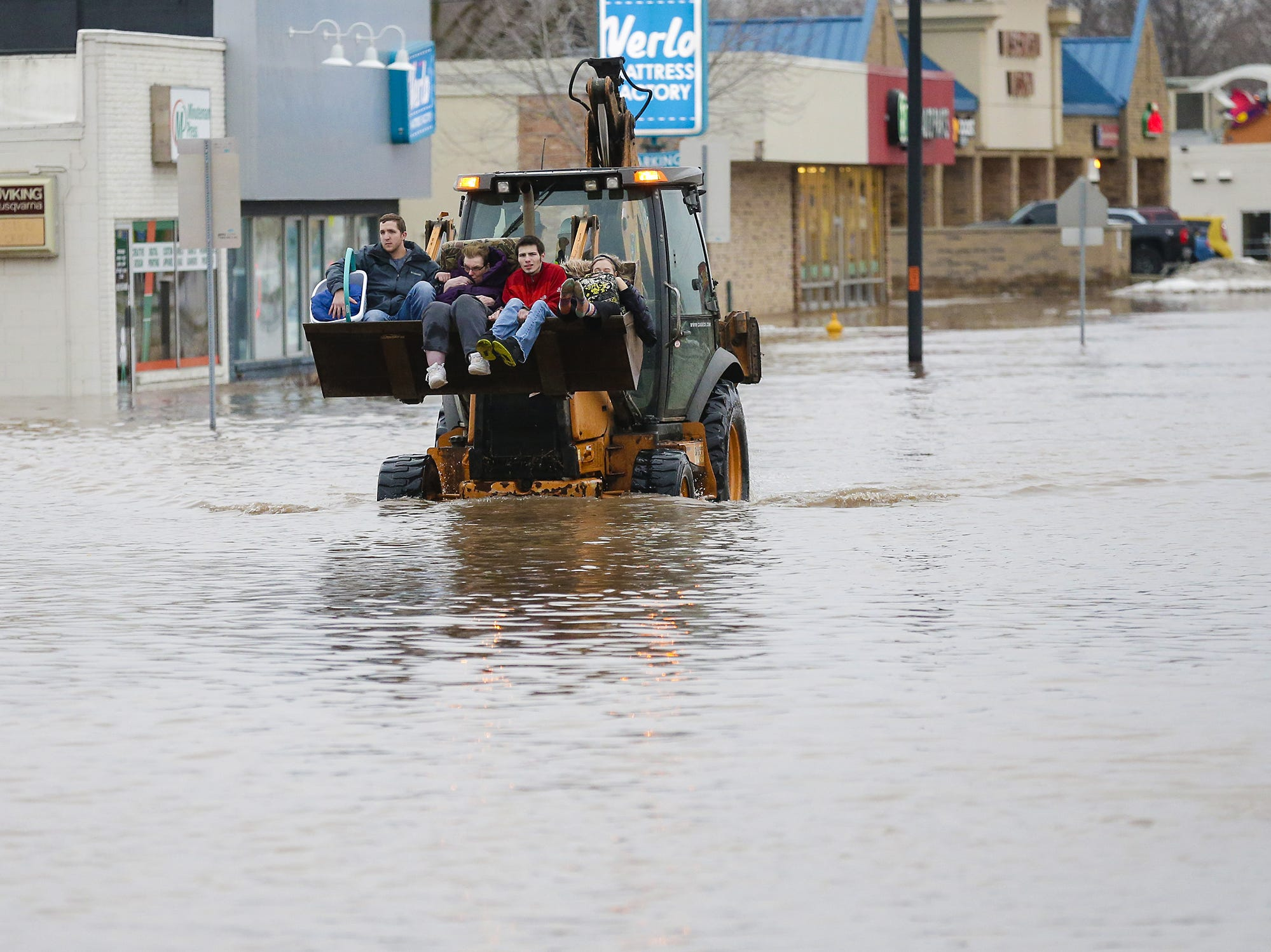 Four people are evacuated from a flooded area Thursday, March 14, 2019 on Johnson Street in Fond du Lac, Wis. Thursday, March 14, 2019. Ice jams on the east branch of the Fond du Lac River and heavy rain caused widespread flooding problems in the city. Doug Raflik/USA TODAY NETWORK-Wisconsin