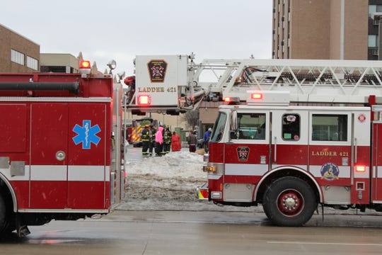 Residents waited outside the Monroe Avenue Apartments, 400 N. Monroe Ave., after the Green Bay Metro Fire Department was called to the 197-unit apartment building about 11 a.m. Friday.