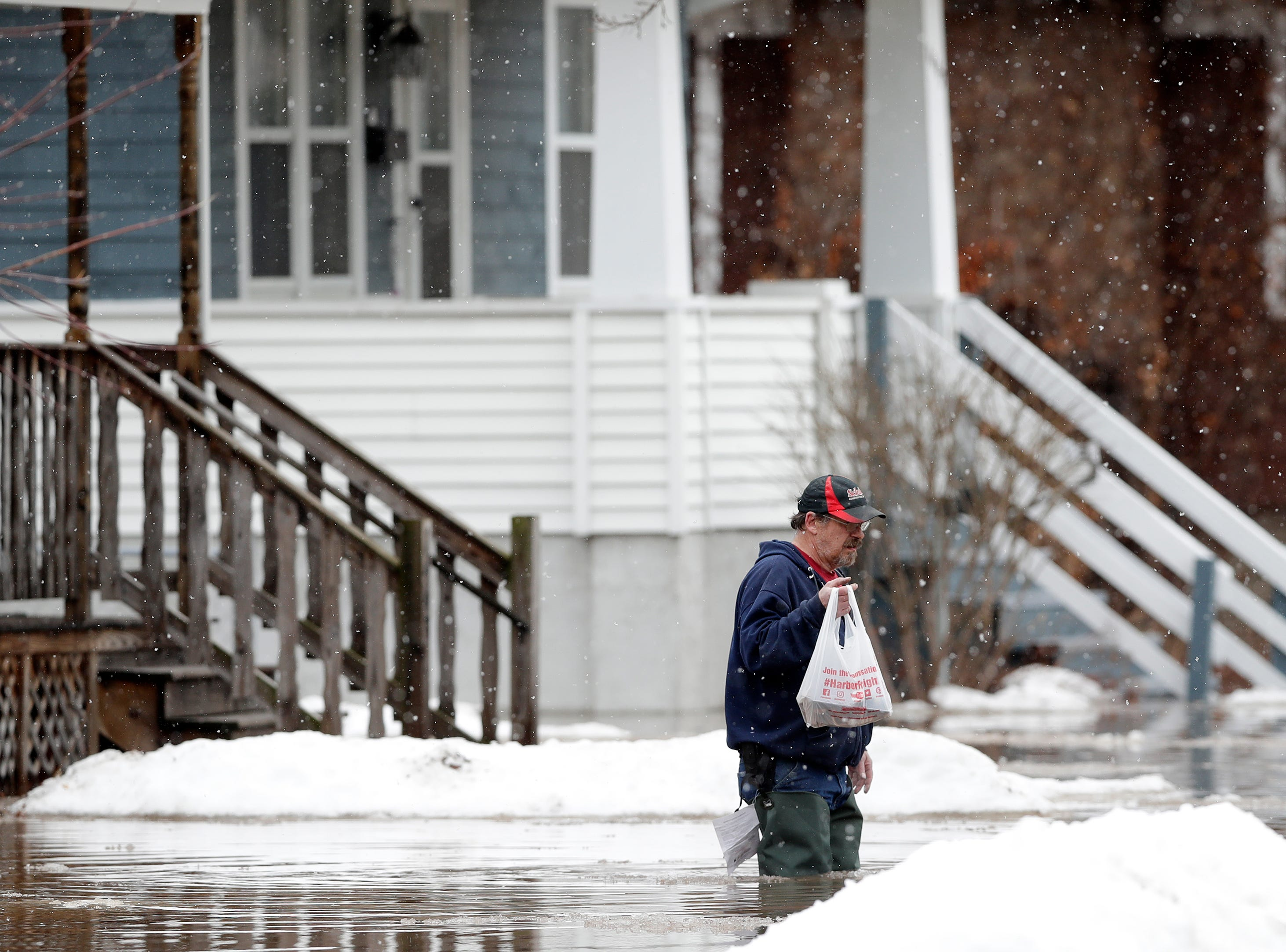 Residents evacuate their homes due to East river floodwaters on Friday, March 15, 2019 in Green Bay, Wis.