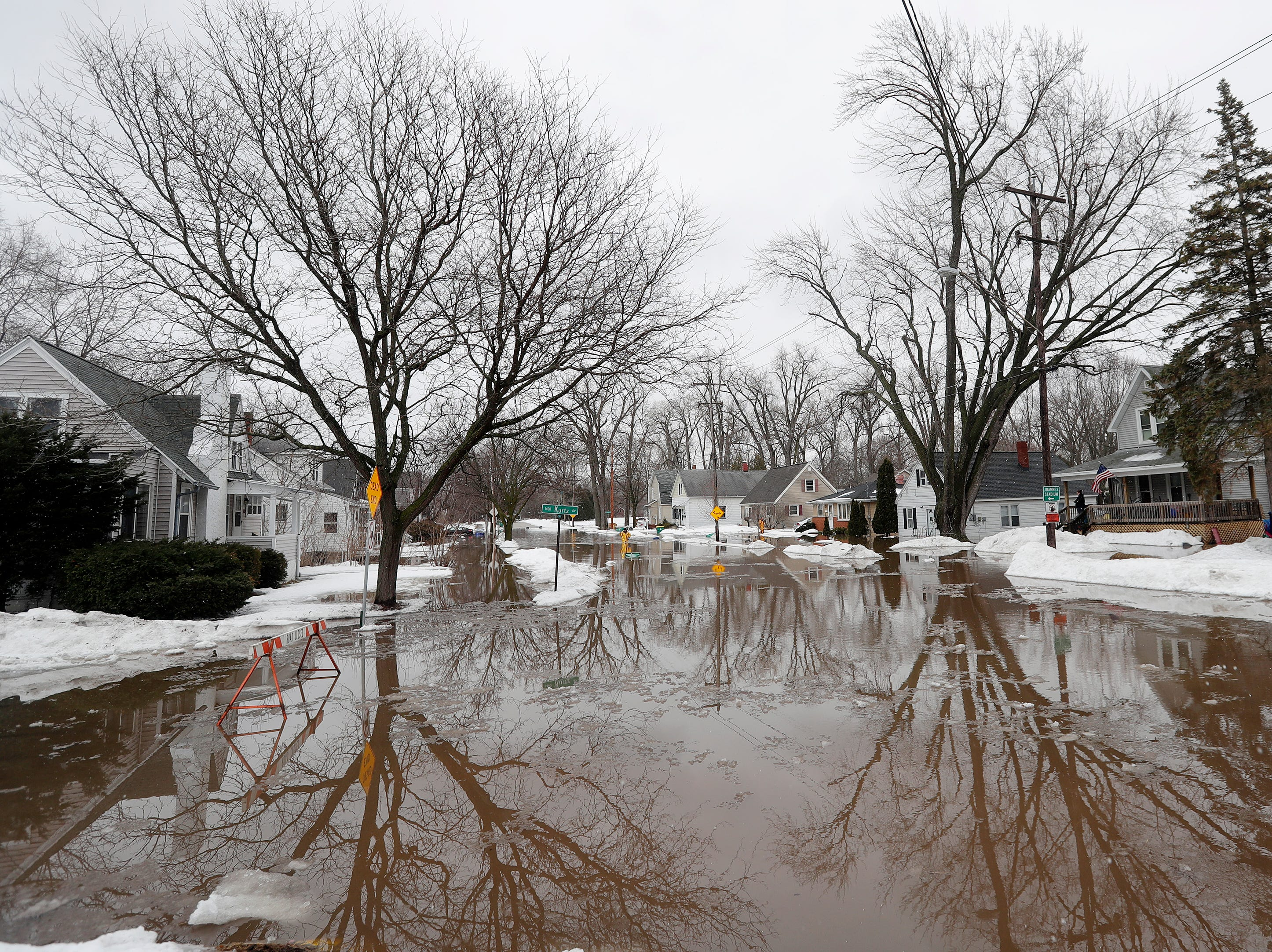 Crooks Street is submerged by East river floodwaters on Friday, March 15, 2019 in Green Bay, Wis.