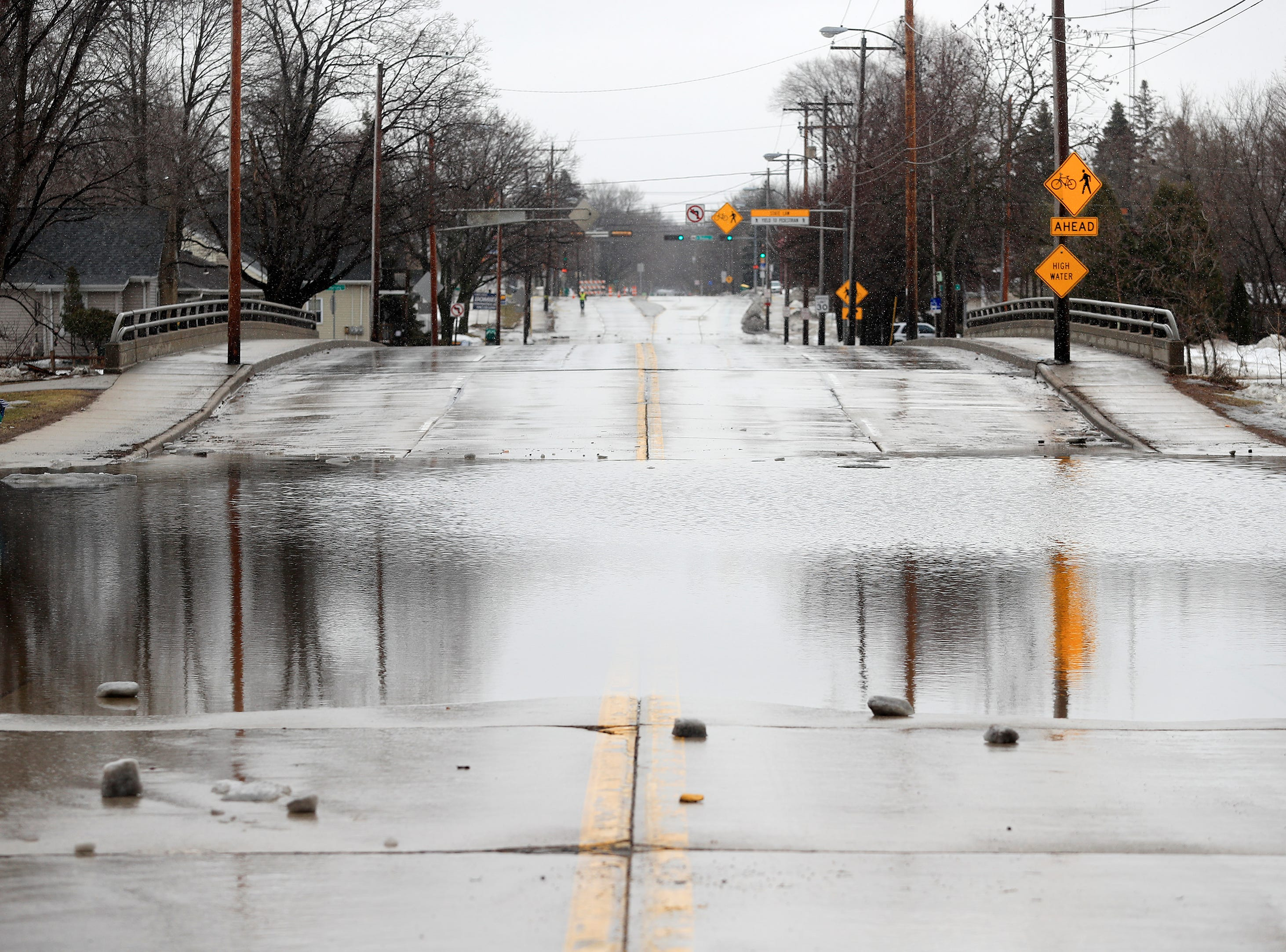 Mason Street is closed due to flooding by the East river on Friday, March 15, 2019 in Green Bay, Wis.