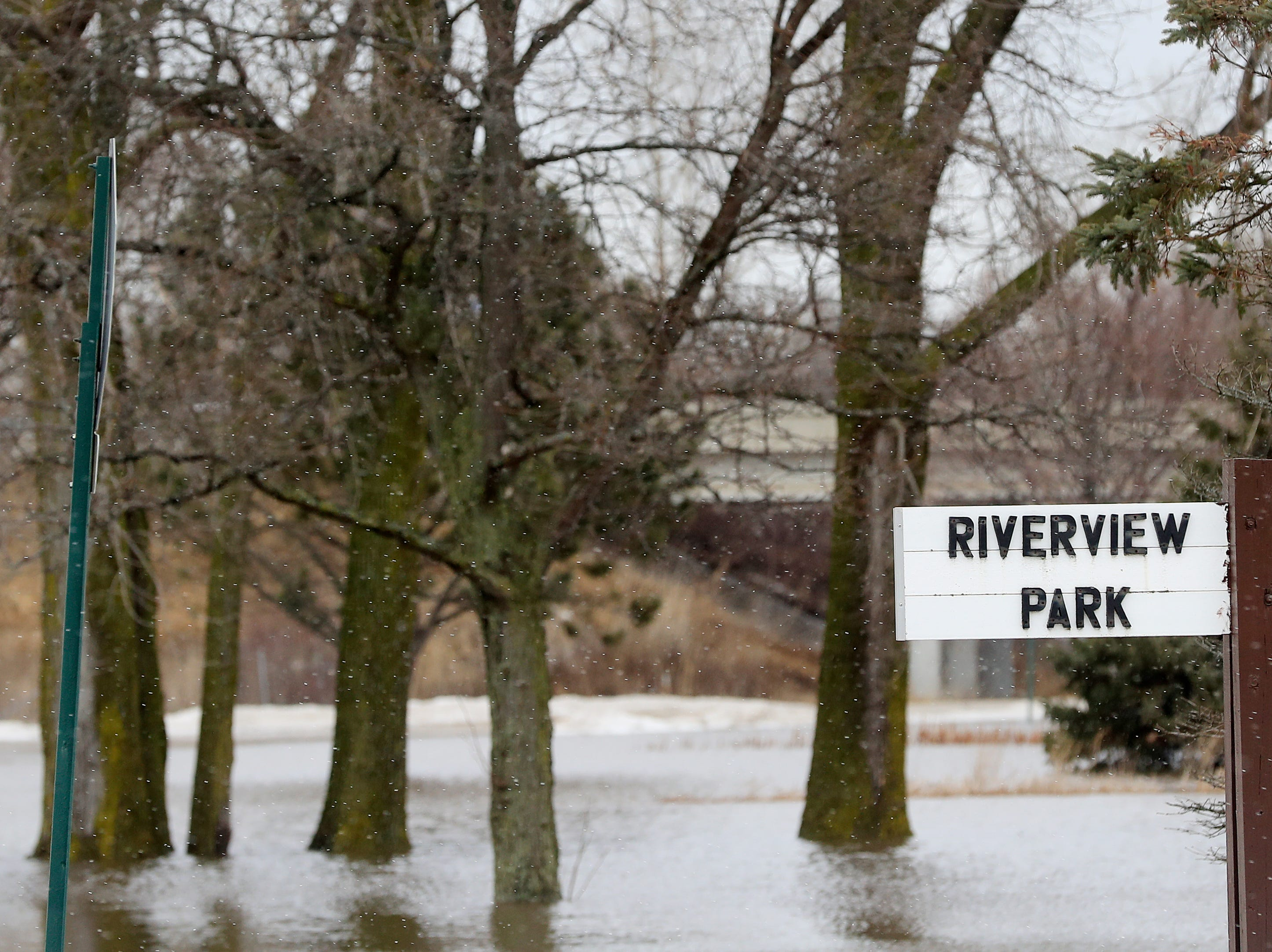 Riverview Park is underwater with East river floodwaters on Friday, March 15, 2019 in Allouez, Wis.