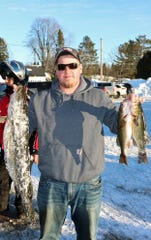 Joe Pribek holds his 11.43-pound Northern during the Red Arrow Snowmobile Club's Fish A Ree held in February. Pribek took first place in the Northern category with the catch.