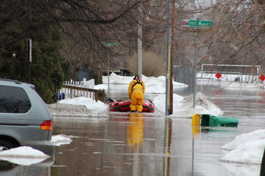 Emergency responders evacuated residents Friday morning from a neighborhood on Hartung Street, near Mason Street on the east bank of the East River.