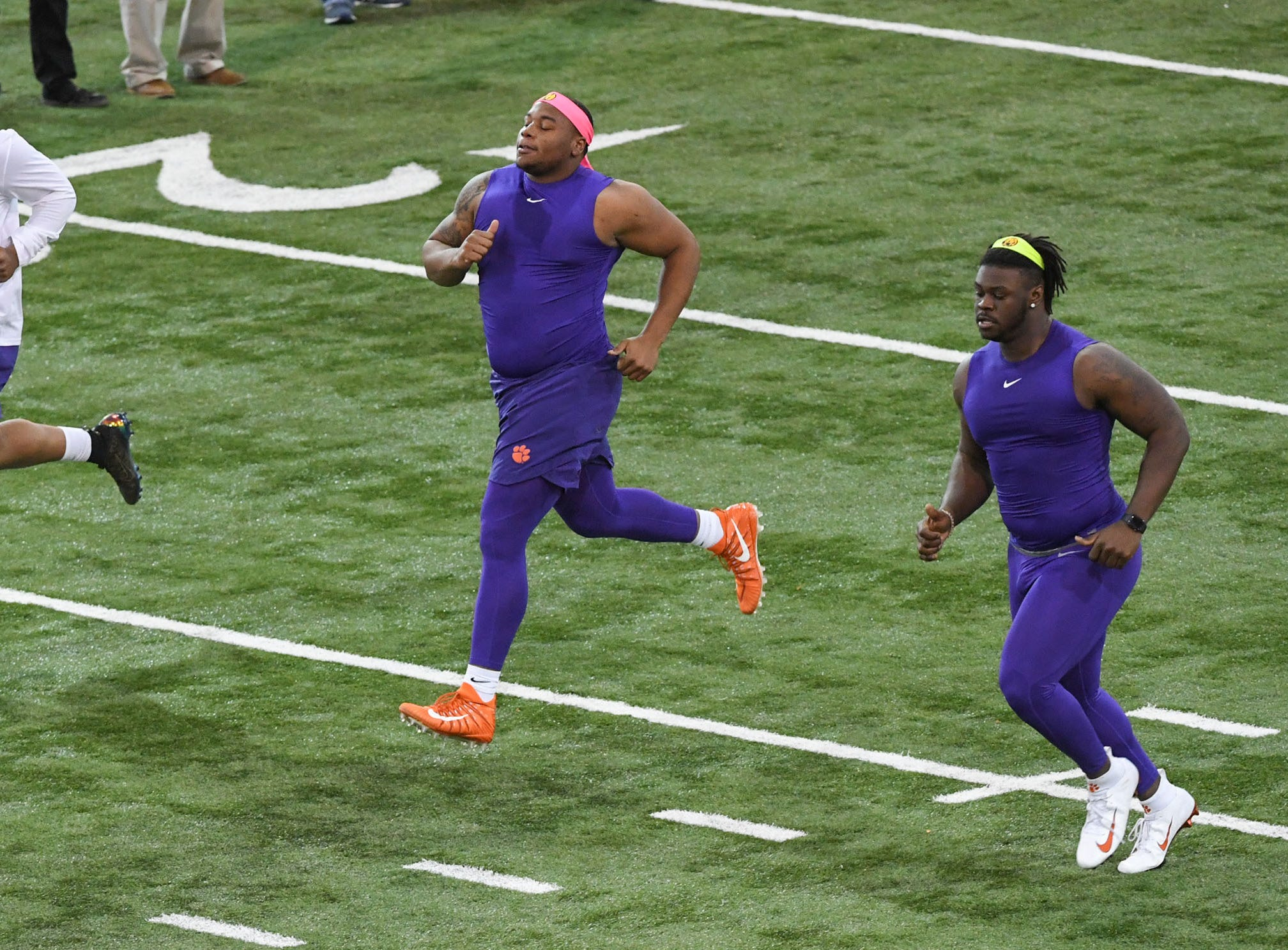 Defensive lineman Christian Wilkins, left, Dexter Lawrence, and Albert Huggins Jr. run for NFL scouts during Clemson Pro Day at the Poe Indoor Facility in Clemson, S.C. Thursday, March 14, 2019.