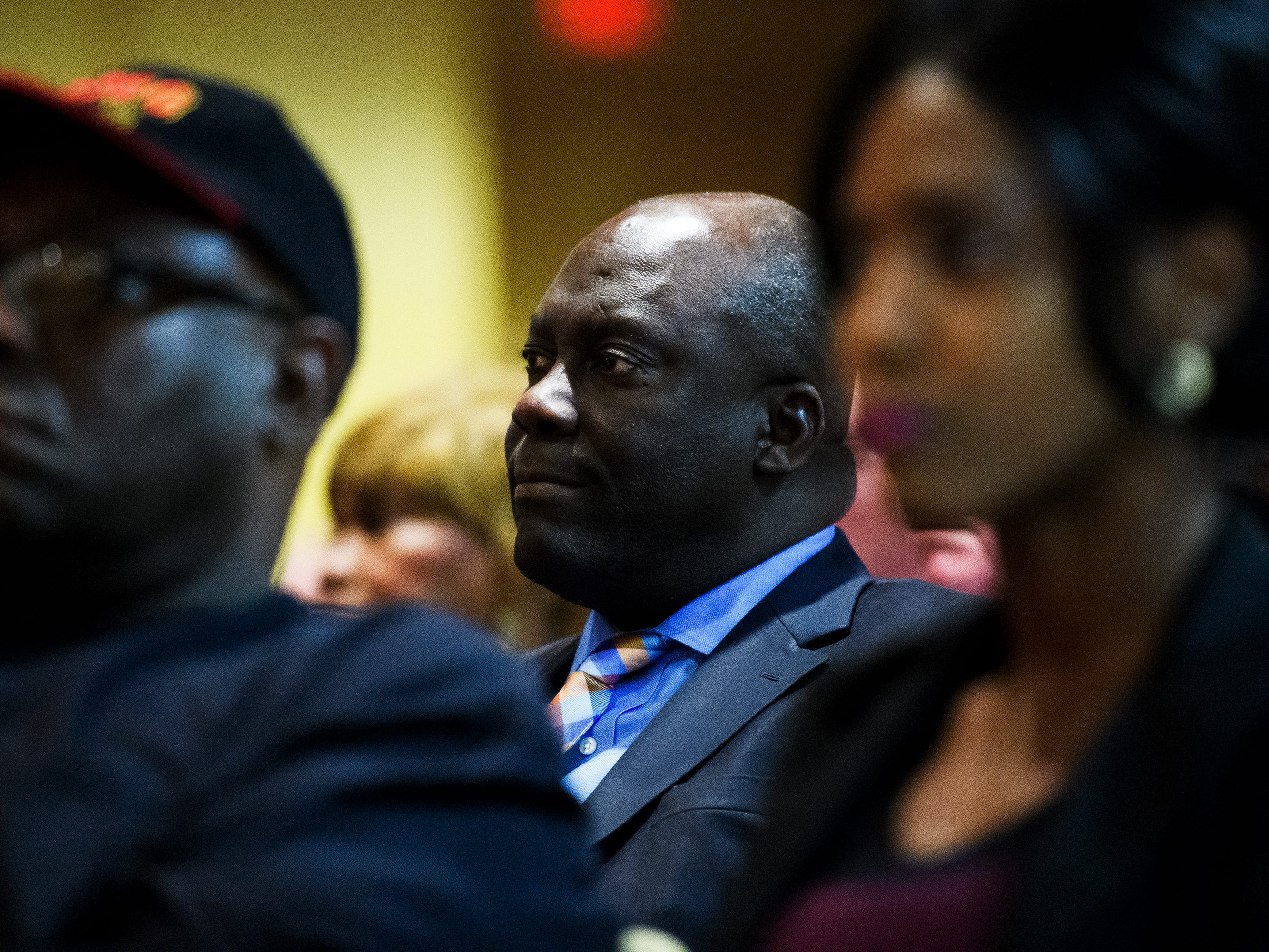 Duke Energy executive Kodwo Ghartey-Tagoe listens as Greenville County residents voice their concerns over a proposed Duke Energy rate increase during a public hearing Thursday, March 14, 2019 at Greenville County Square.