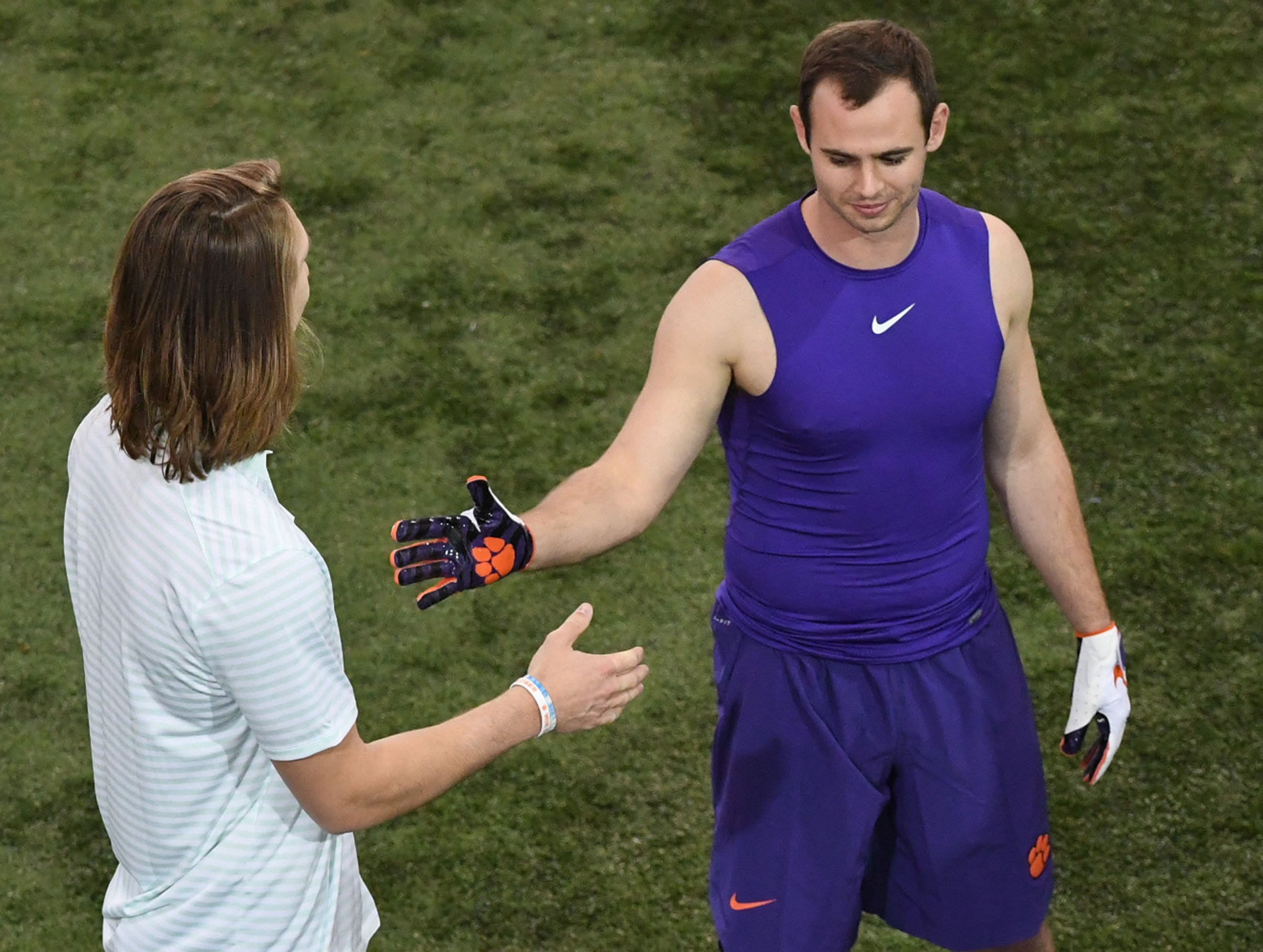 Clemson quarterback Trevor Lawrence, left, greets Wide receiver Hunter Renfrow during Clemson Pro Day at the Poe Indoor Facility in Clemson, S.C. Thursday, March 14, 2019.