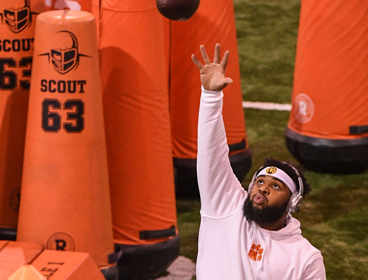 Defensive lineman Christian Wilkins reaches for a one-handed catch warming up for Clemson Pro Day at the Poe Indoor Facility in Clemson, S.C. Thursday, March 14, 2019.
