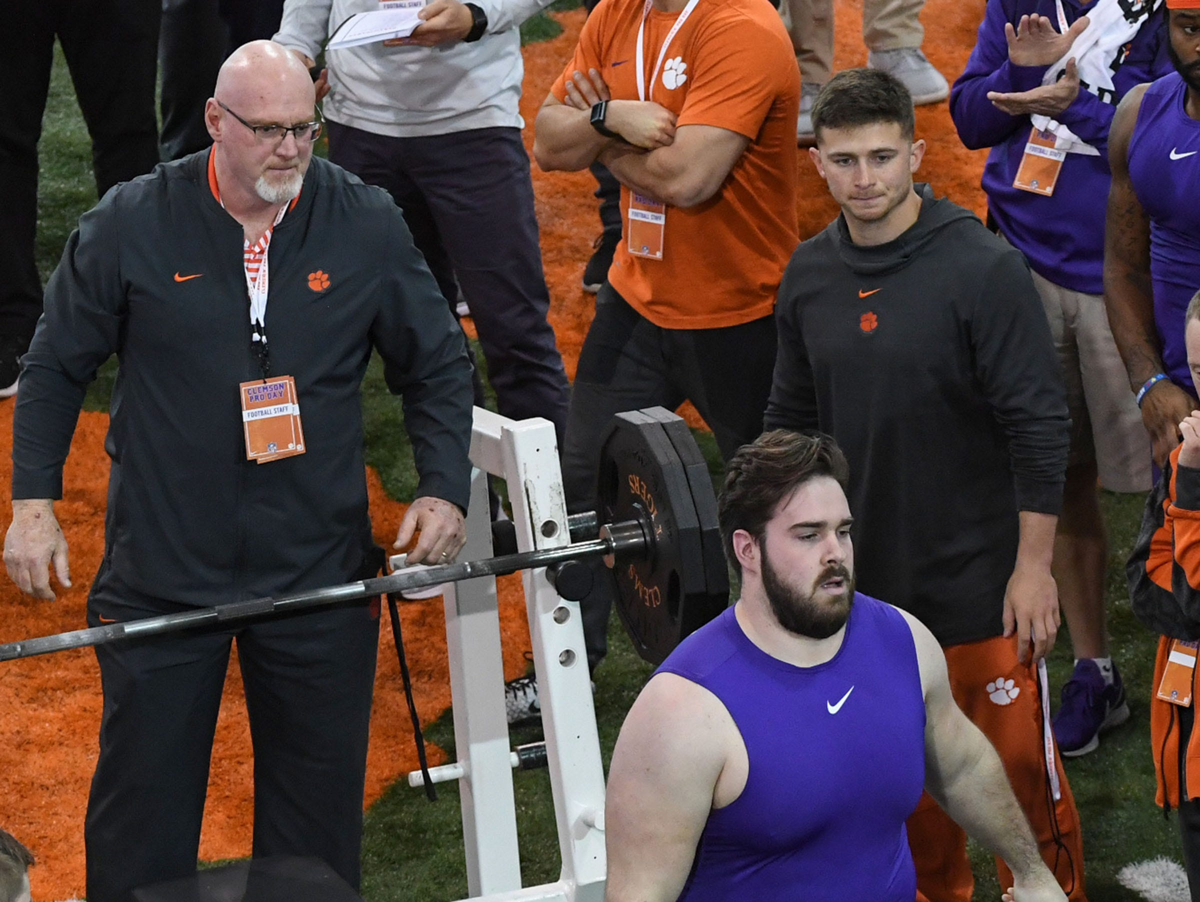 Offensive lineman Justin Falcinelli assisted by strength trainer Joey Batson after 27 reps of 225 pounds in the bench press during Clemson Pro Day at the Poe Indoor Facility in Clemson, S.C. Thursday, March 14, 2019.