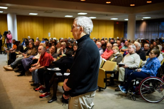 Furman University lecturer of economics Robert Arden waits to speak during a public hearing on proposed Duke Energy rate increases Thursday, March 14, 2019 at Greenville County Square.