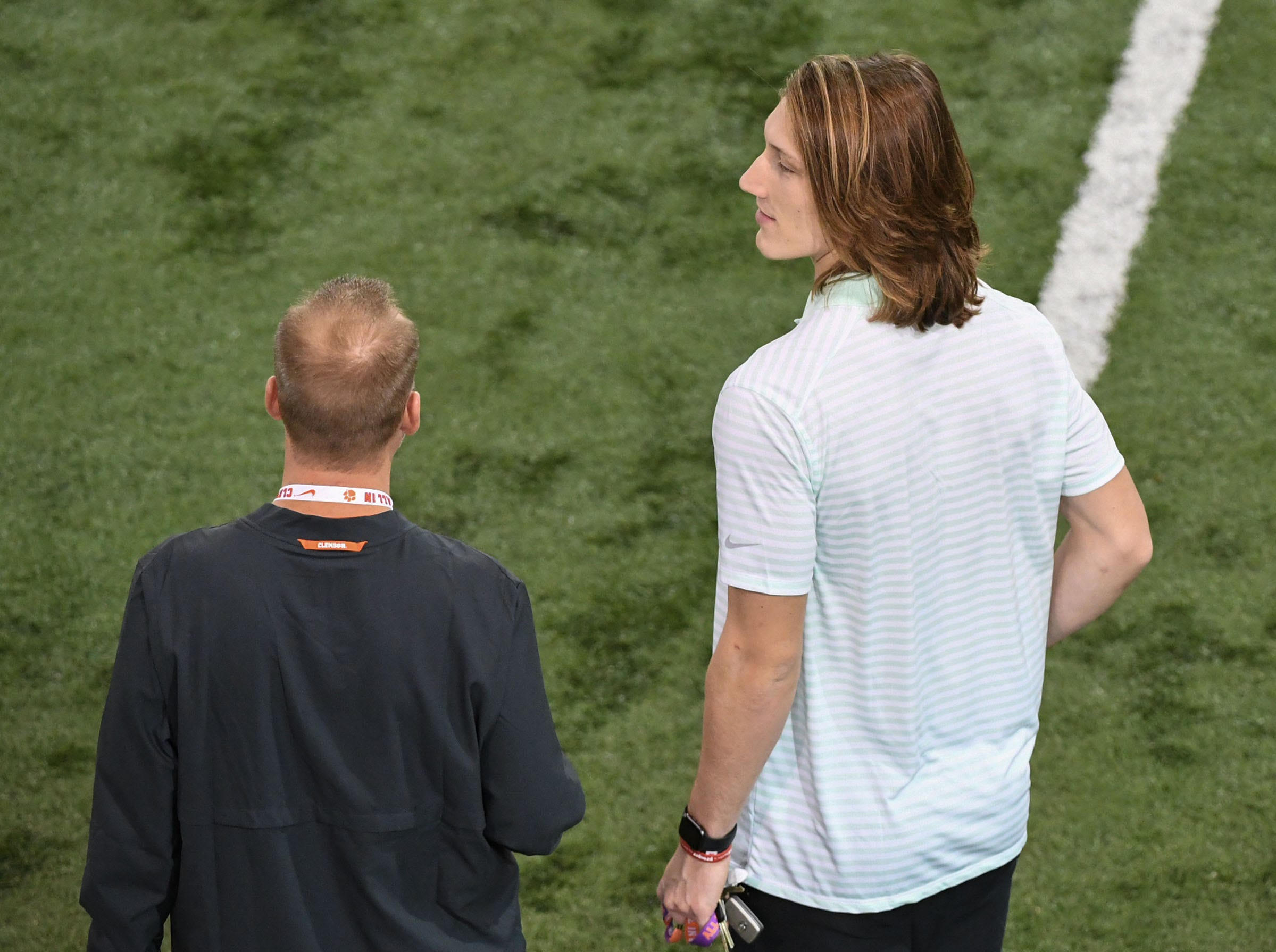 Clemson quarterback coach Brandon Streeter, left, with quarterback Trevor Lawrence during Clemson Pro Day at the Poe Indoor Facility in Clemson, S.C. Thursday, March 14, 2019.