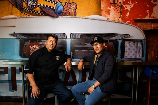 "Jorge ""Papi"" Barrales and Jorge Barrales Jr. pose for a portrait at Papi's Tacos Friday, March 15, 2019."