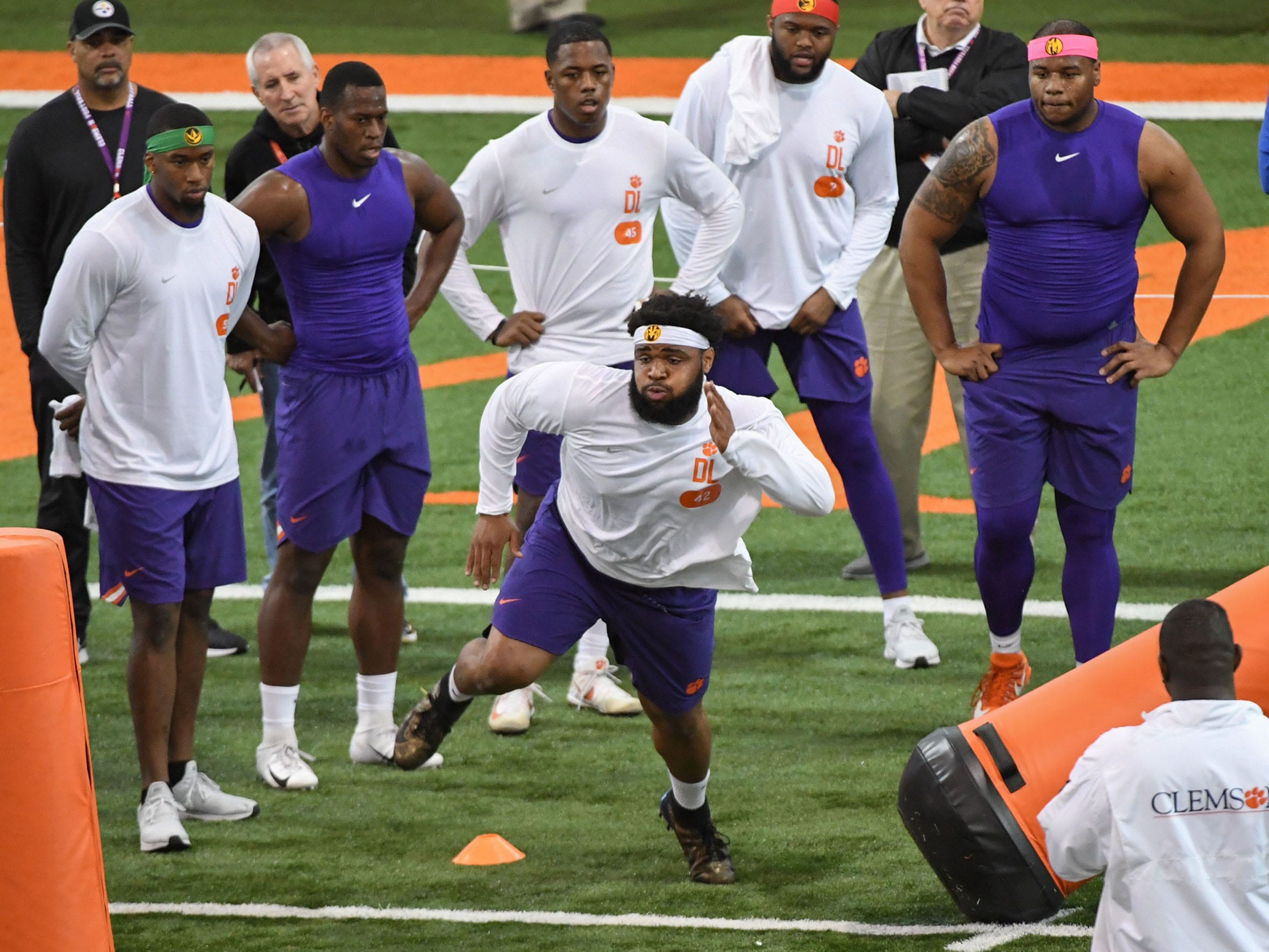 Defensive lineman Christian Wilkins runs a drill near former Clemson football teammates during Clemson Pro Day at the Poe Indoor Facility in Clemson, S.C. Thursday, March 14, 2019. Watching are, from left; Clelin Ferrell, Tre Lamar III, Chris Register II, Austin Bryant , and Dexter Lawrence.