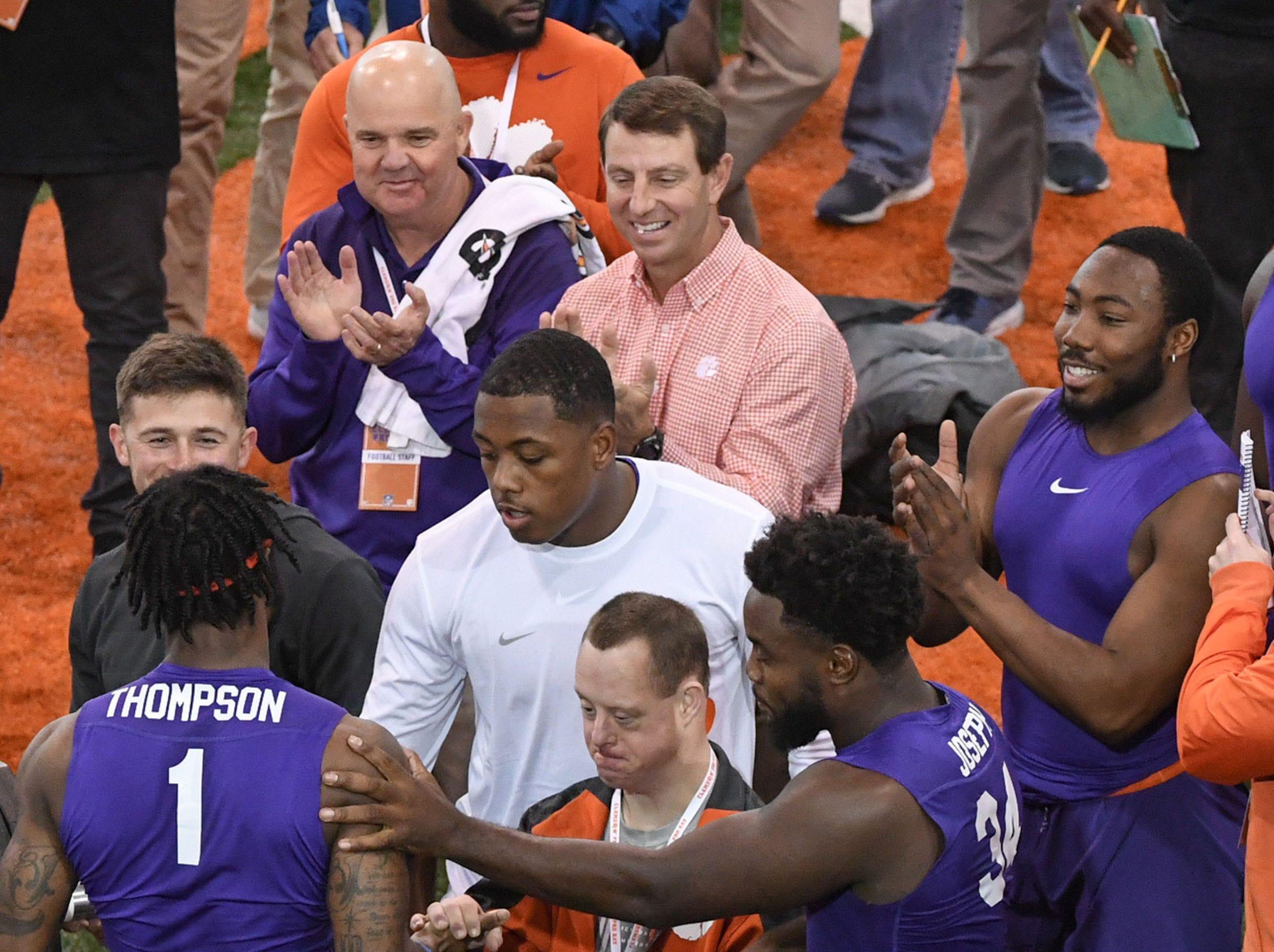 Wide receiver Trevion Thompson is congratulated after testing in the bench press during Clemson Pro Day at the Poe Indoor Facility in Clemson, S.C. Thursday, March 14, 2019. Thompson had 16 reps of 225 pounds.
