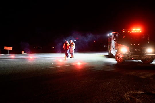 Emergency personnel from Frenchtown respond to the scene on Highway 93 North at Waldo Road after two related shooting late Thursday night and early Friday morning prompted a manhunt near Evaro Hill.