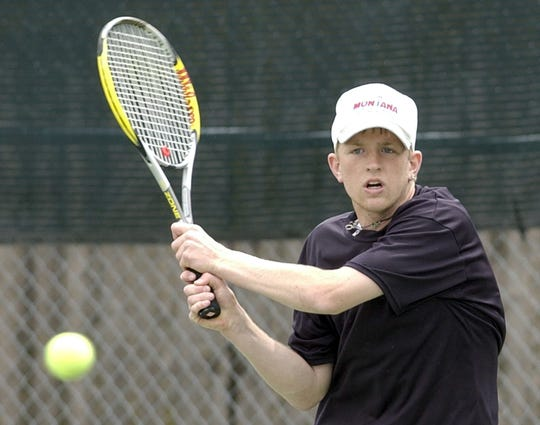 Cut Bank's Keithan Gregg backhands the ball back to teammate Brian McDivitt during the Montana boys' Class B-C singles championship match in Missoula on May 22, 2004. Gregg defeated McDivitt 6-1, 6-3 to win his fourth straight B-C singles title. (AP Photo/Missoulian, Tom Bauer)