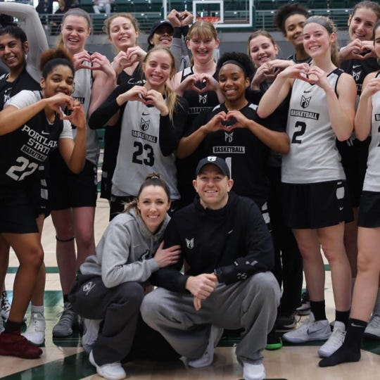 Members of the Portland State women's basketball team pose with assistant coaches Chelsey and Keithan Gregg. The girls are showing their affection for the husband-wife coaching tandem for a Valentine's Day feature that appeared in a Portland publication.
