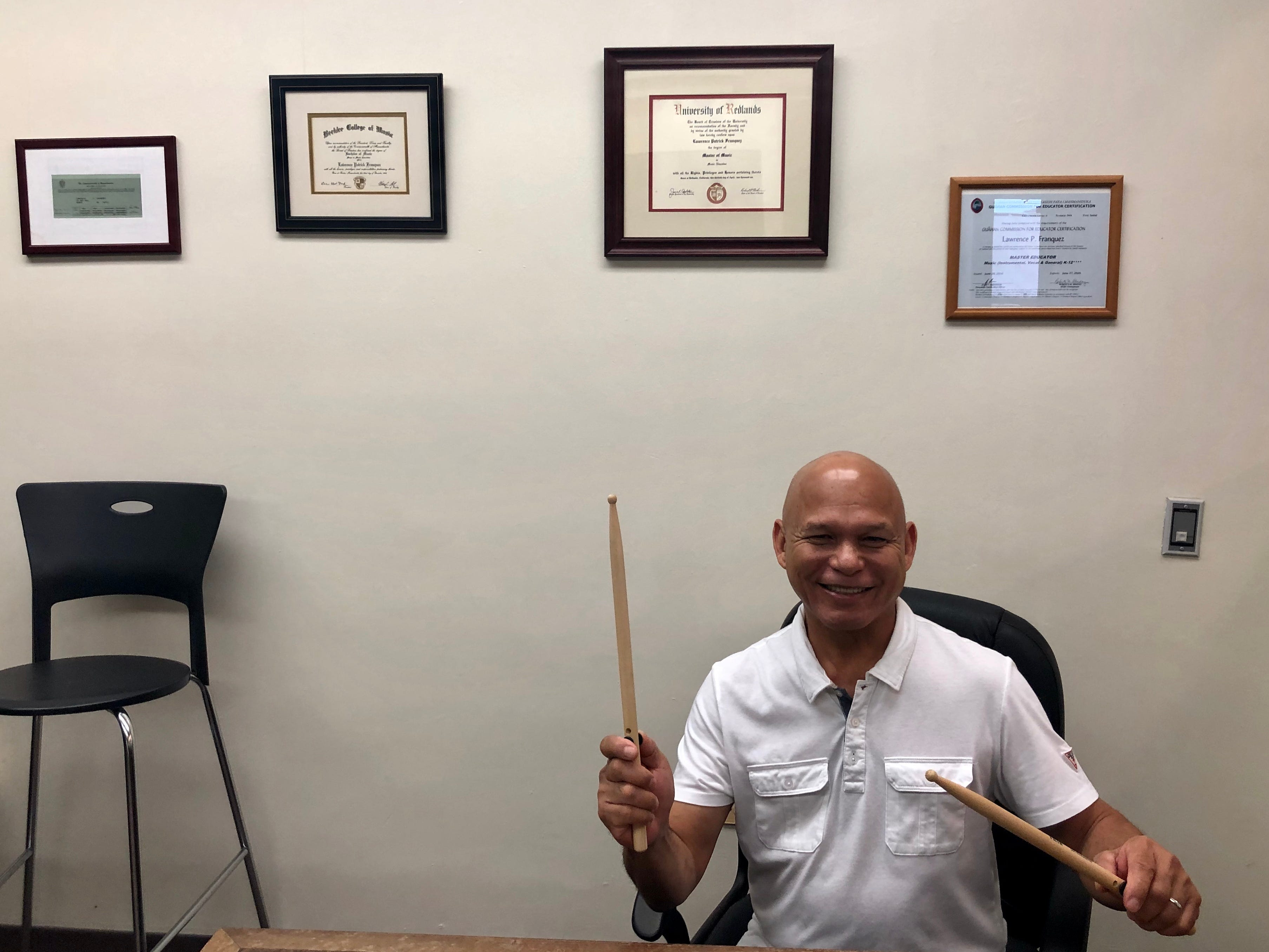 Larry Franquez, Southern High School band director and music professional pictured in front of his achievements on March 15, 2019.