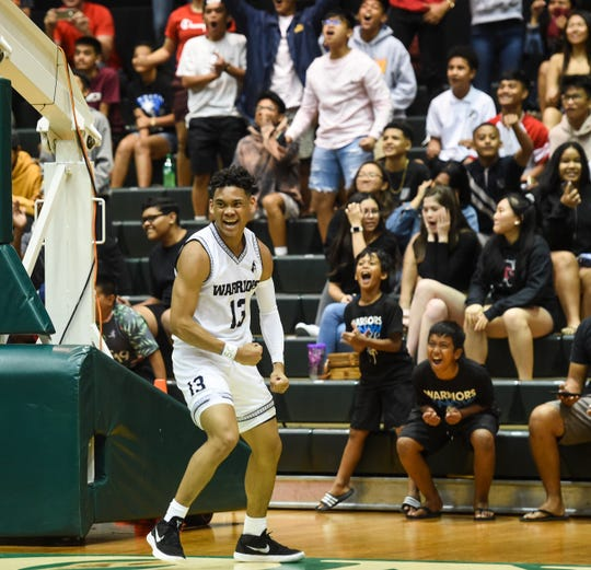 Jahmar White celebrates after a fast-break bucket during the IIAAG Boys Basketball title game against the Father Duenas Friars at the University of Guam Calvo Field House in this March 15 file photo. White, the league MVP, led Saint Paul to a 44-41 win.