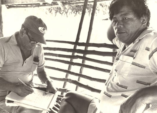 In June 1981, Frank Palacios, left, of the   Commonwealth Disaster Program Office, compiles a list of damage to public and private property on Pagan with the help of Northern Islands Mayor Dan Castro. Pagan lost its airstrip and much of its livestock and sustained heavy property damage after the Mt. Pagan volcano erupted May 15, 1981.